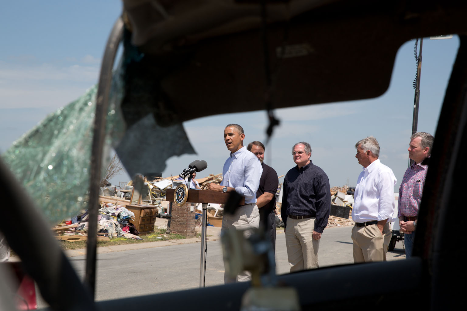 President Barack Obama delivers a statement regarding the recent tornadoes and severe storms in central Arkansas, in Vilonia, Ark., May 7, 2014.