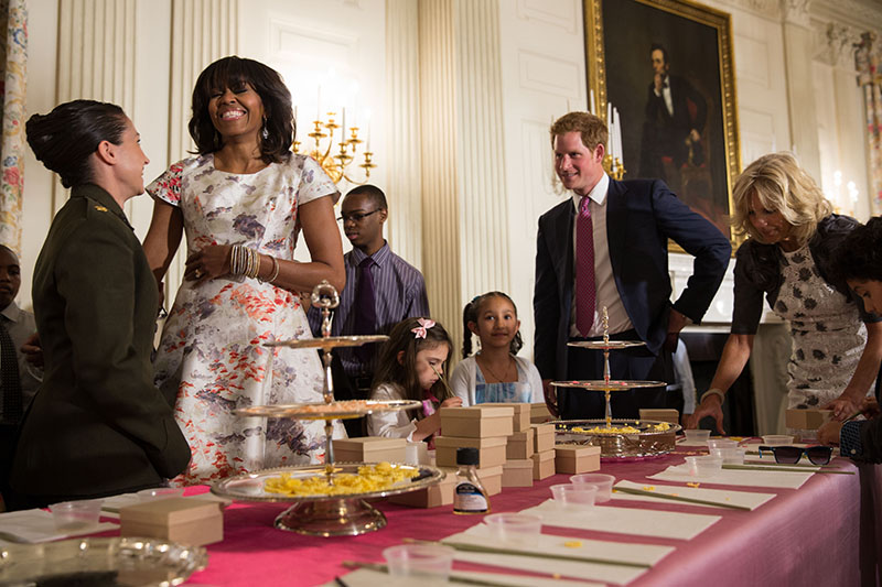 First Lady Michelle Obama, Dr. Jill Biden, and Prince Harry of Wales help military children create Mothers Day cards
