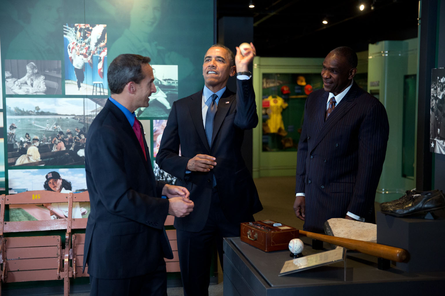 President Barack Obama feigns throwing a ball during a tour of the Baseball Hall of Fame in Cooperstown, N.Y., May 22, 2014.