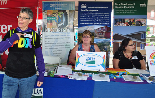 A USDA alumna (left), who attended the Northwest Pride Festival with her partner and their two children