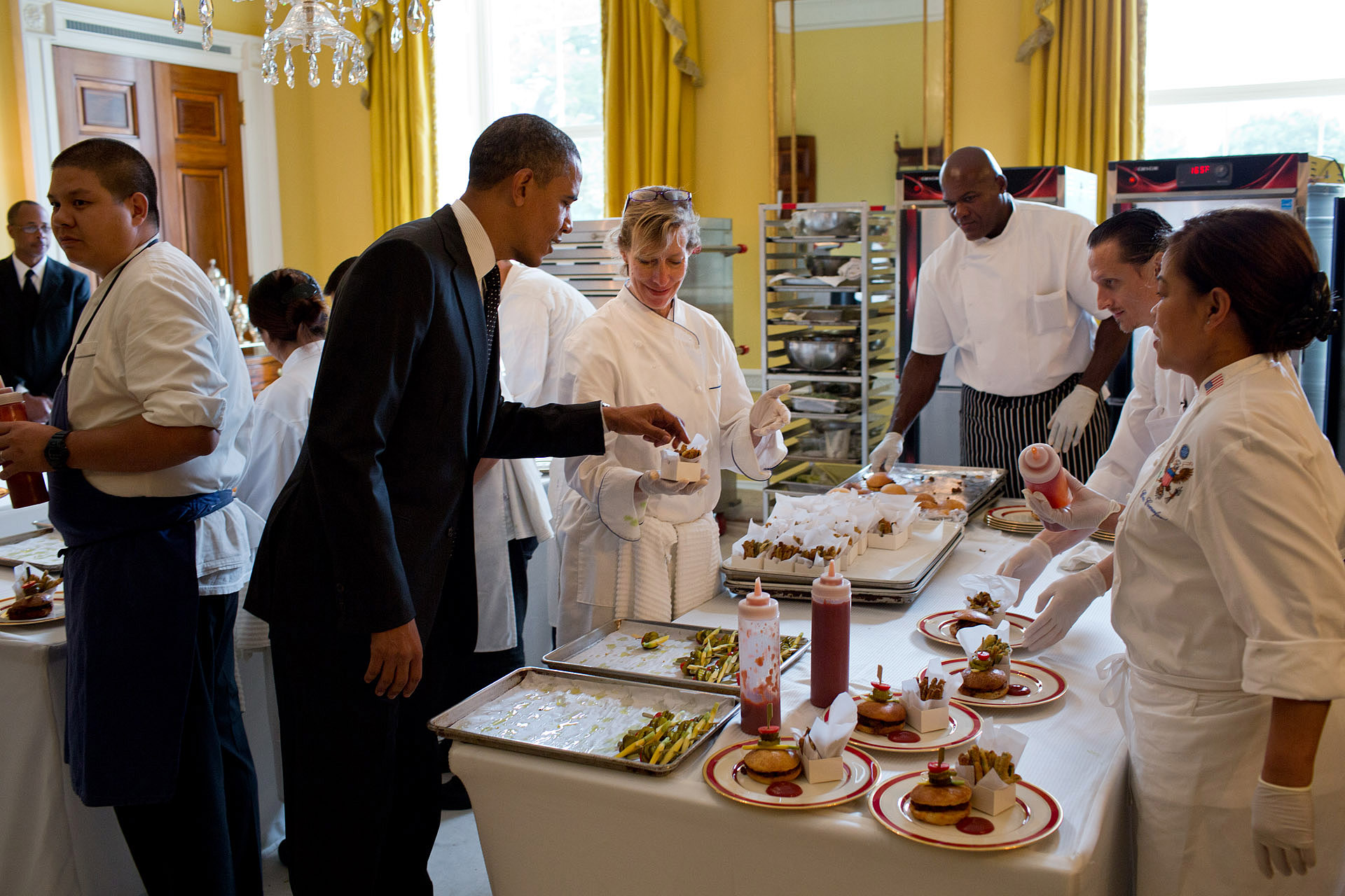 President Barack Obama Samples a Baked Zucchini Fry at the Epicurious Kids' State Dinner