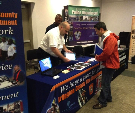 Veterans and military families meet with recruiters at a Veterans Career Fair in Arlington, VA on May 15, 2014.
