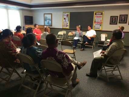 Community members participate in a community roundtable in Springdale, AK