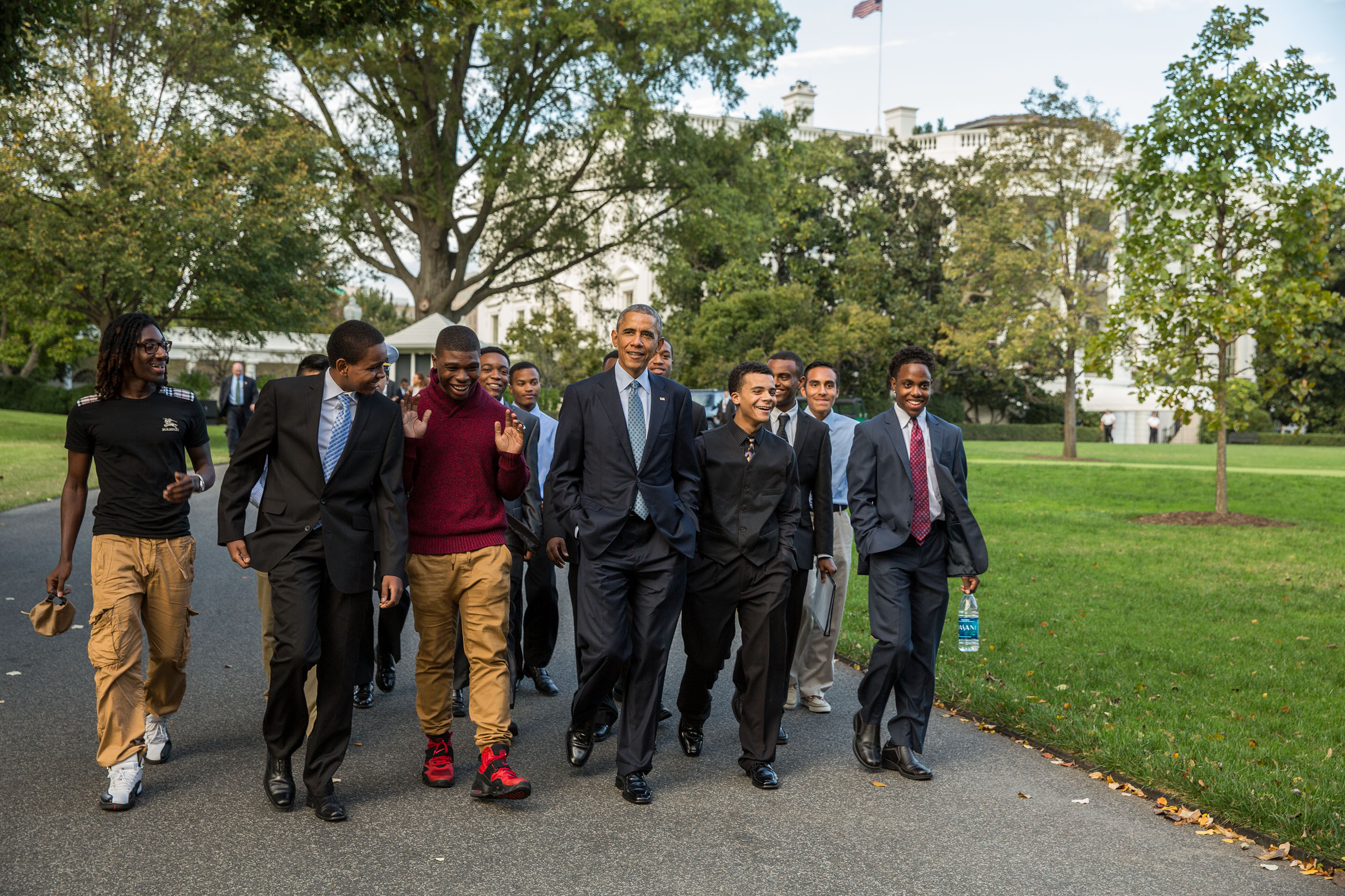 President Barack Obama walks with mentees on the South Lawn of the White House