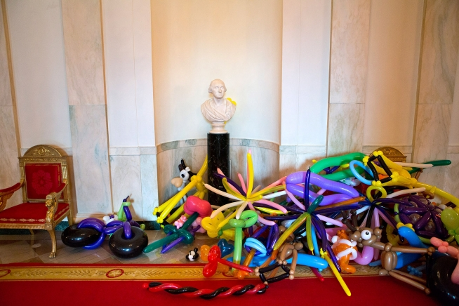 Balloon creations are piled under the George Washington bust in the Cross Hall of the White House