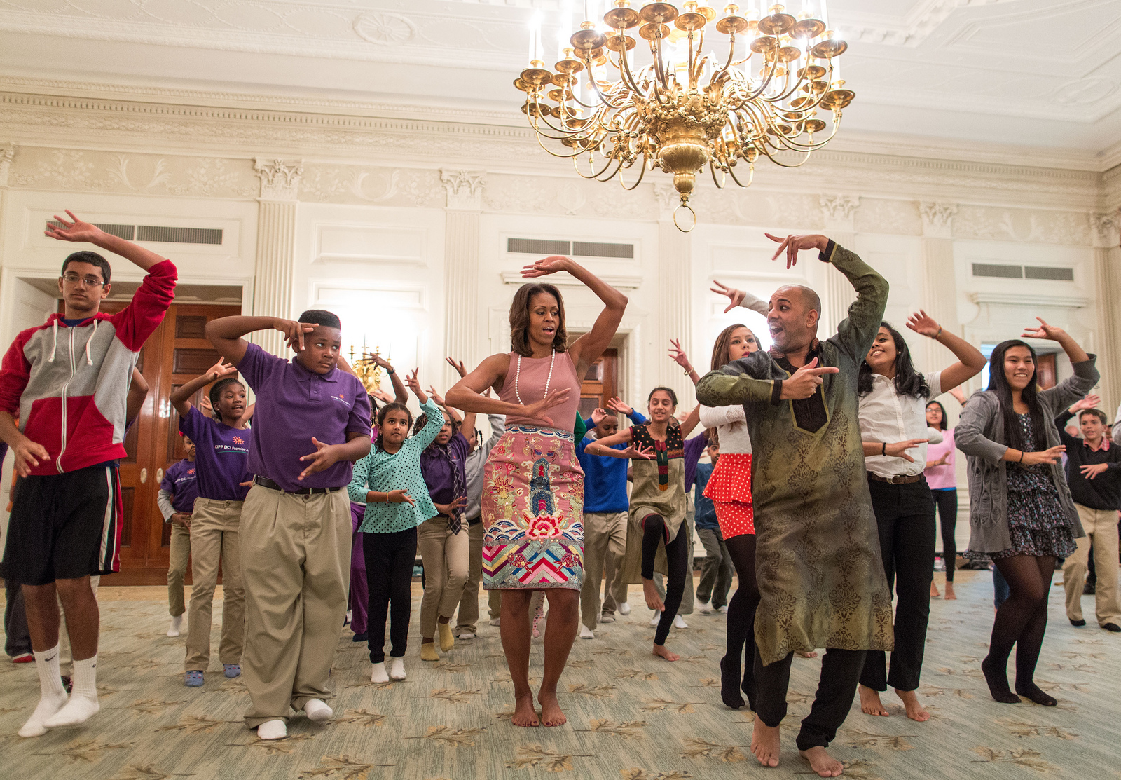 First Lady Michelle Obama joins students for a Bollywood Dance Clinic in the State Dining Room of the White House.