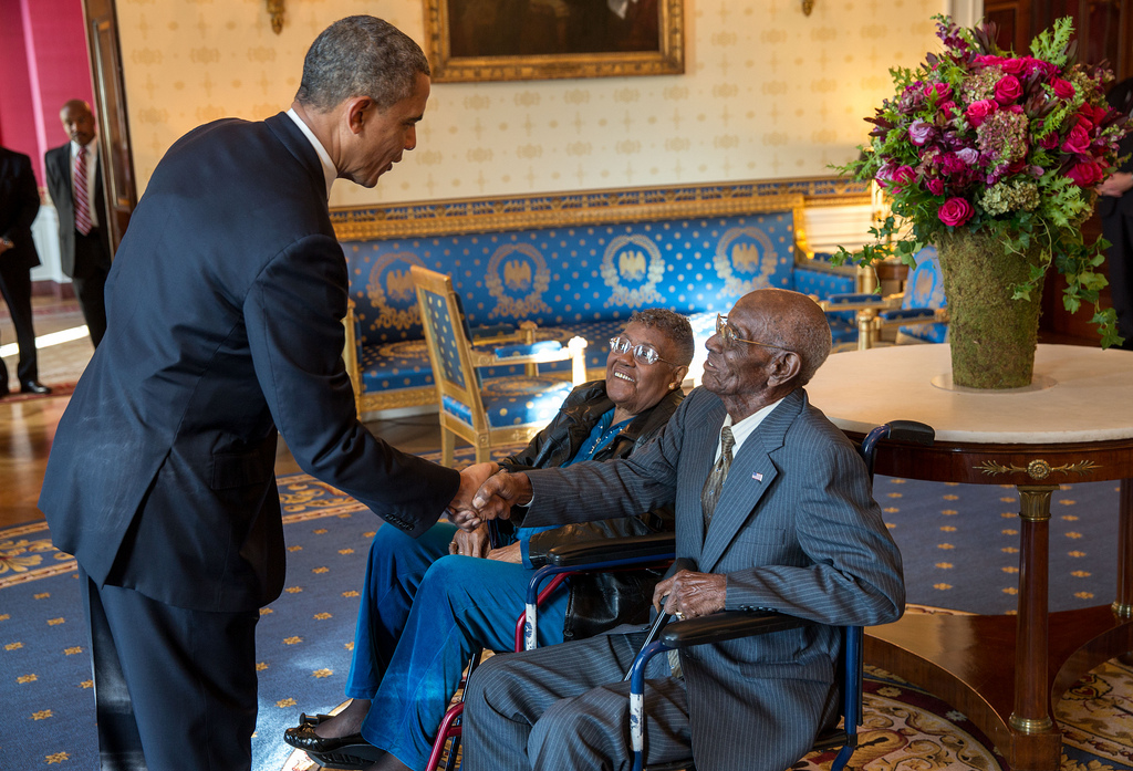 President Barack Obama greets Richard Overton, with Earlene Love-Karo, in the Blue Room of the White House.