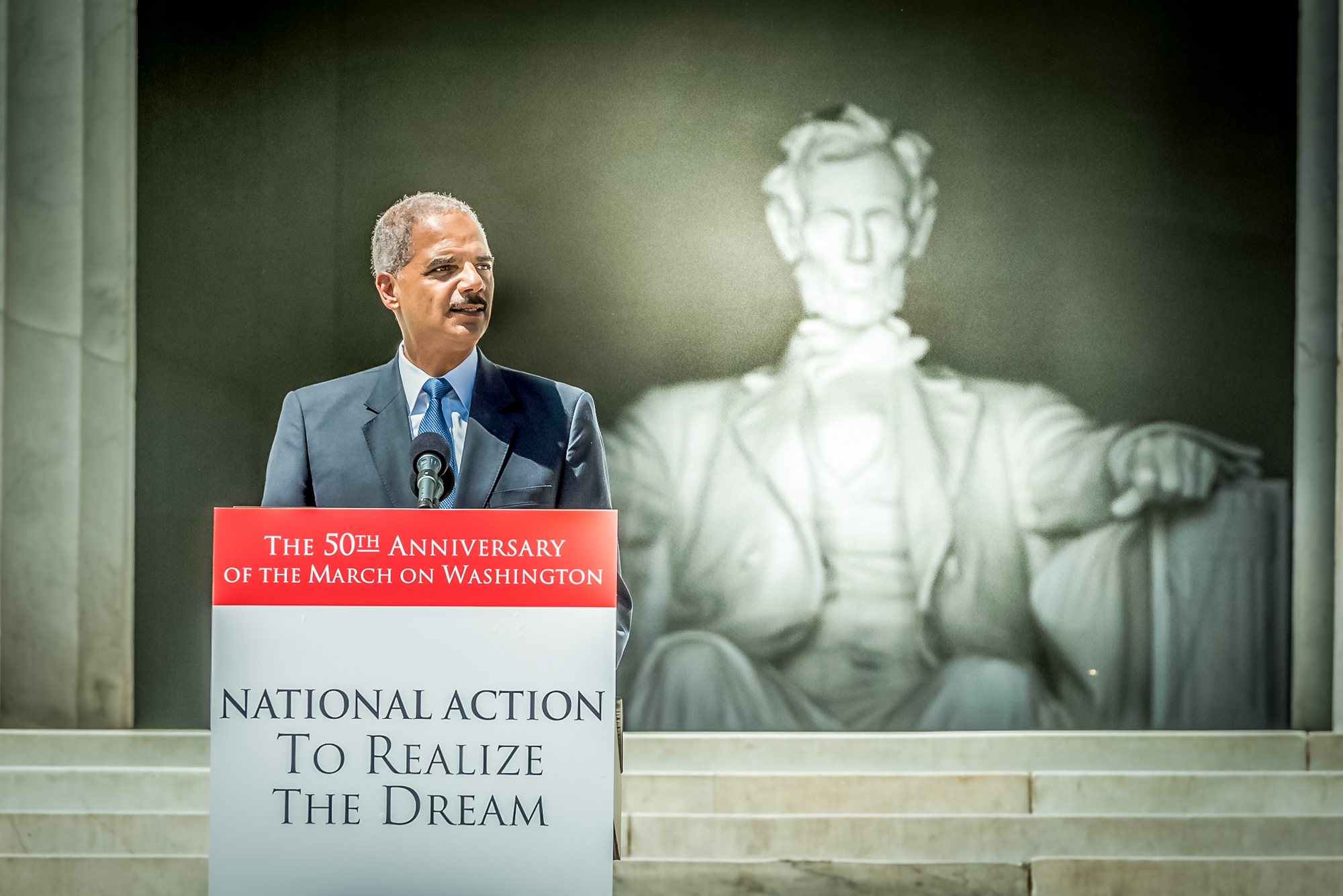 Attorney General Eric Holder speaks at the National Action to Realize the Dream March