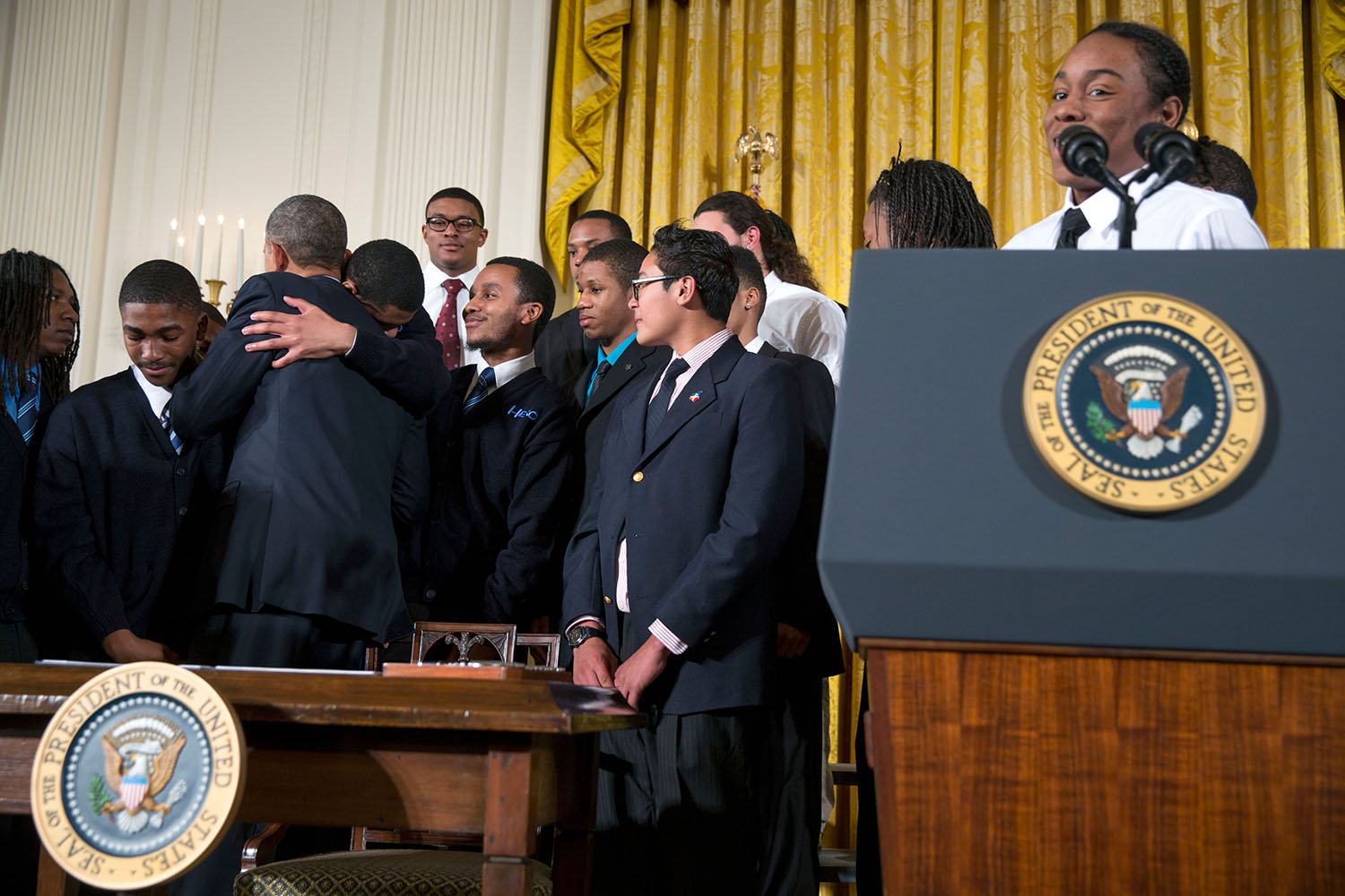 President Obama hugs a participant after signing a Presidential Memorandum establishing the My Brother's Keeper Task Force