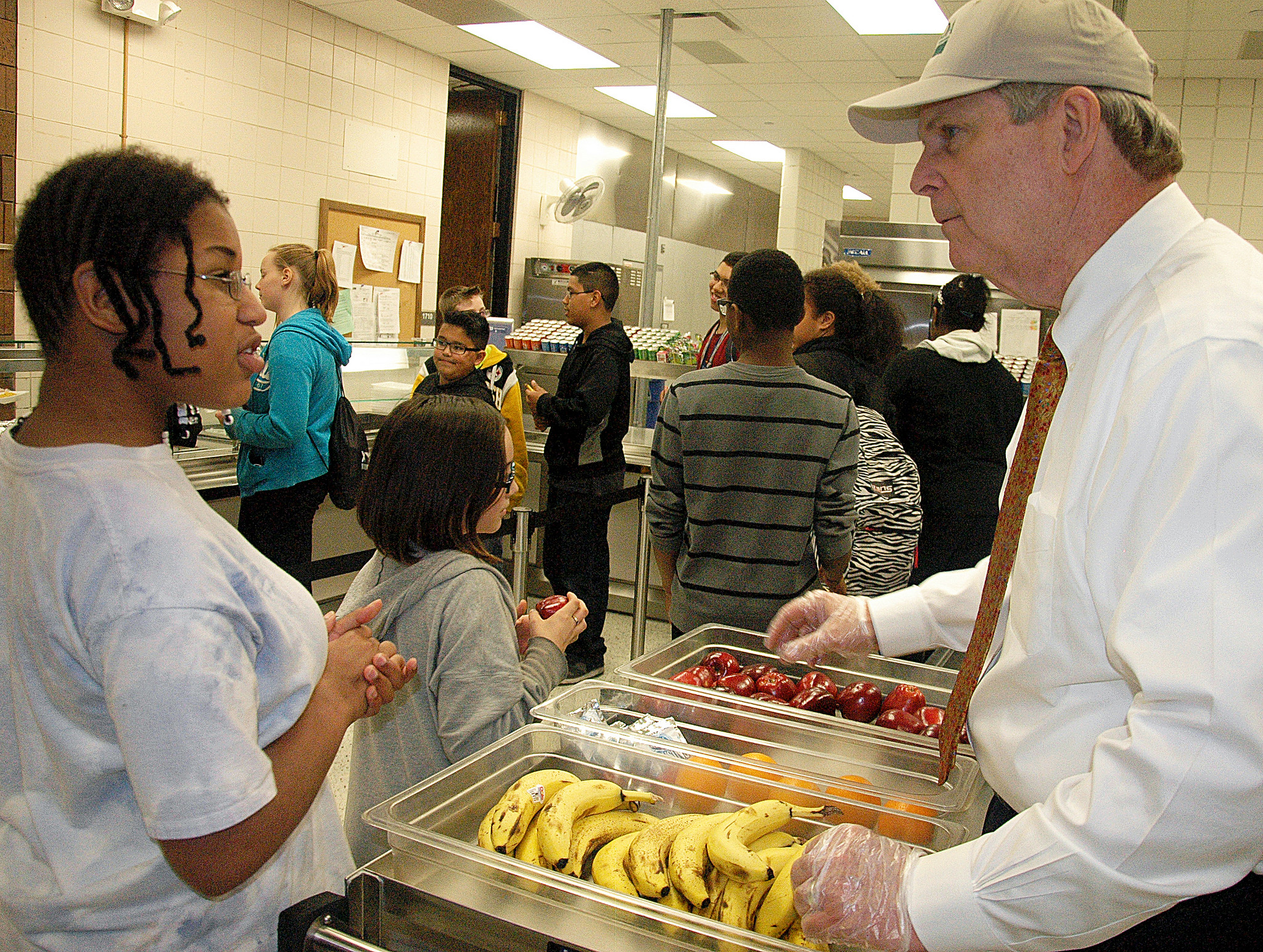 Agriculture Secretary Tom Vilsack serves Des Moines, IA McCombs Middle School student Miracle Kizer