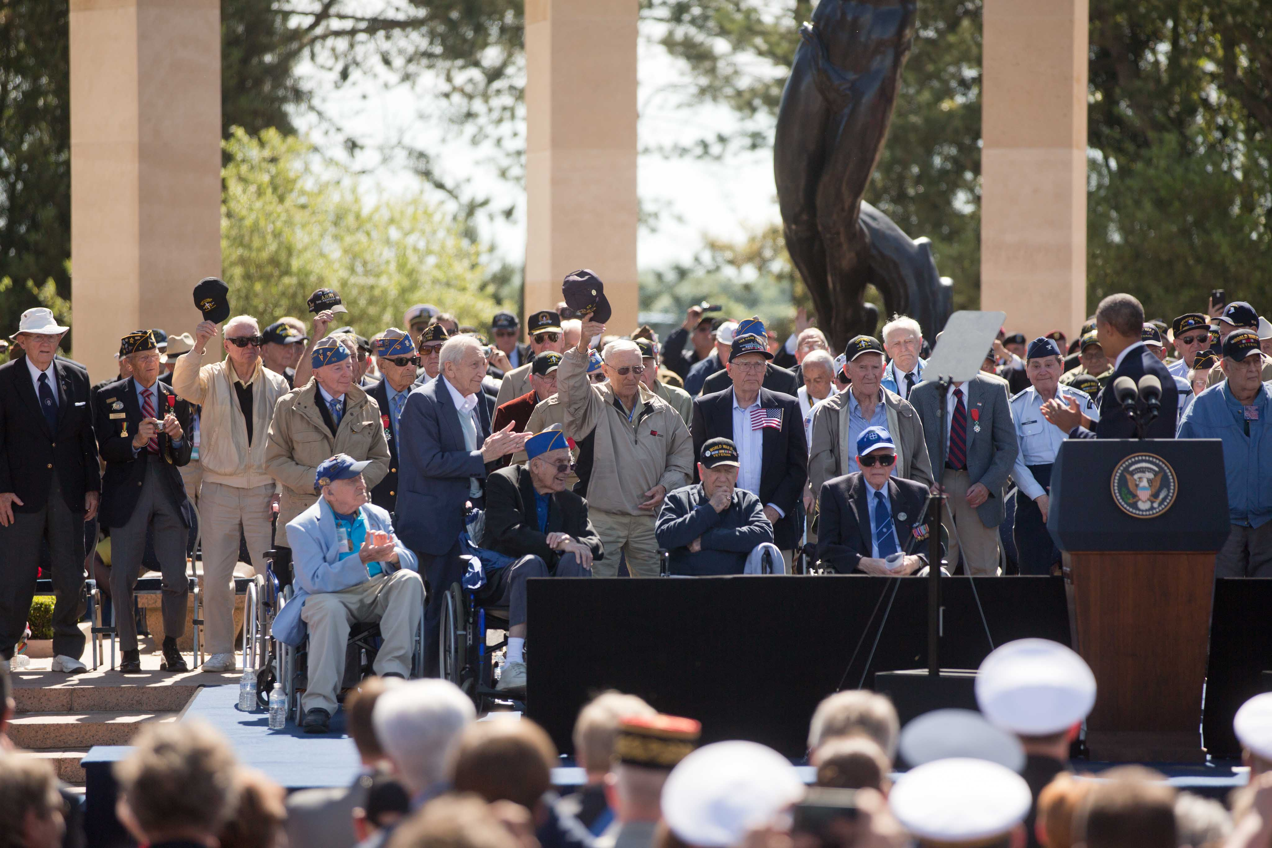 President Barack Obama acknowledges veterans during the 70th French-American Commemoration D-Day Ceremony