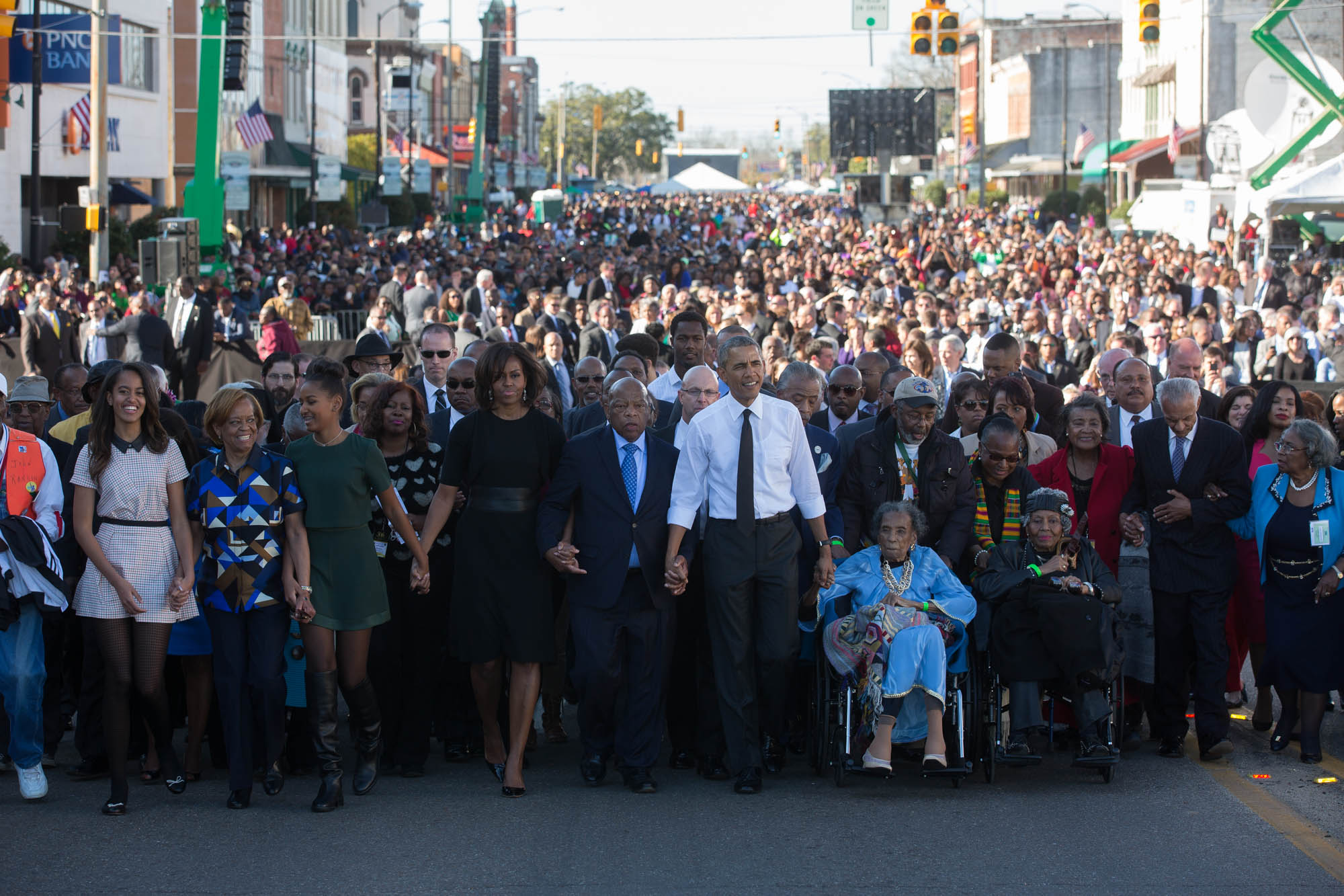The First Family waits with former President George W. Bush, former First Lady Laura Bush prior to the walking across the Edmund Pettus Bridge