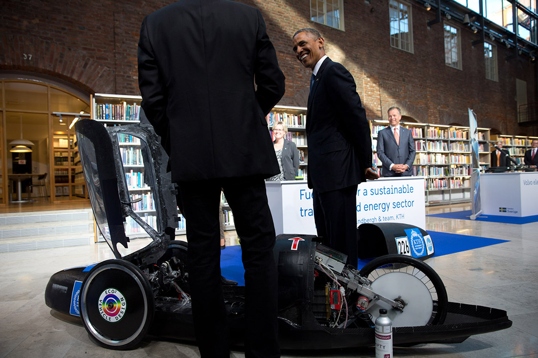President Barack Obama is shown an example of a vehicle that uses fuel cells during an energy expo at the Royal Institute of Technology in Stockholm, Sweden