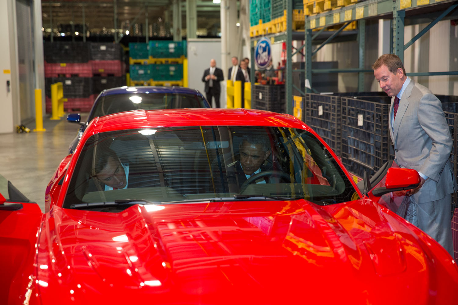 President Obama sits in a Mustang with Ford CEO Mark Fields