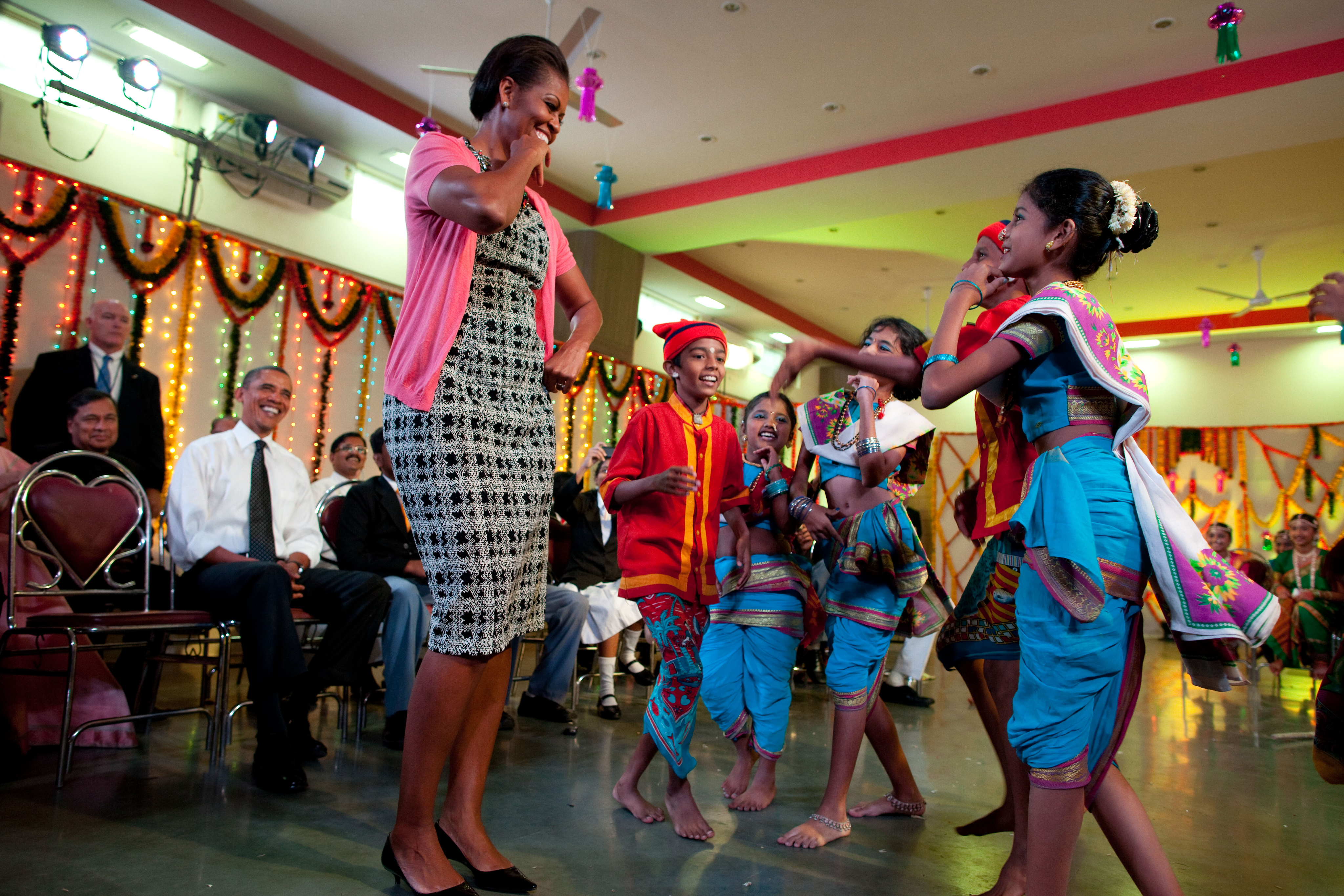 First Lady Michelle Obama dances with students during Diwali