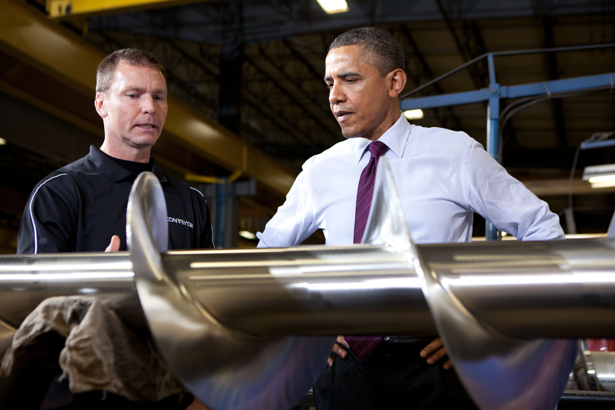 President Barack Obama looks at an agricultural auger in Cedar Rapids