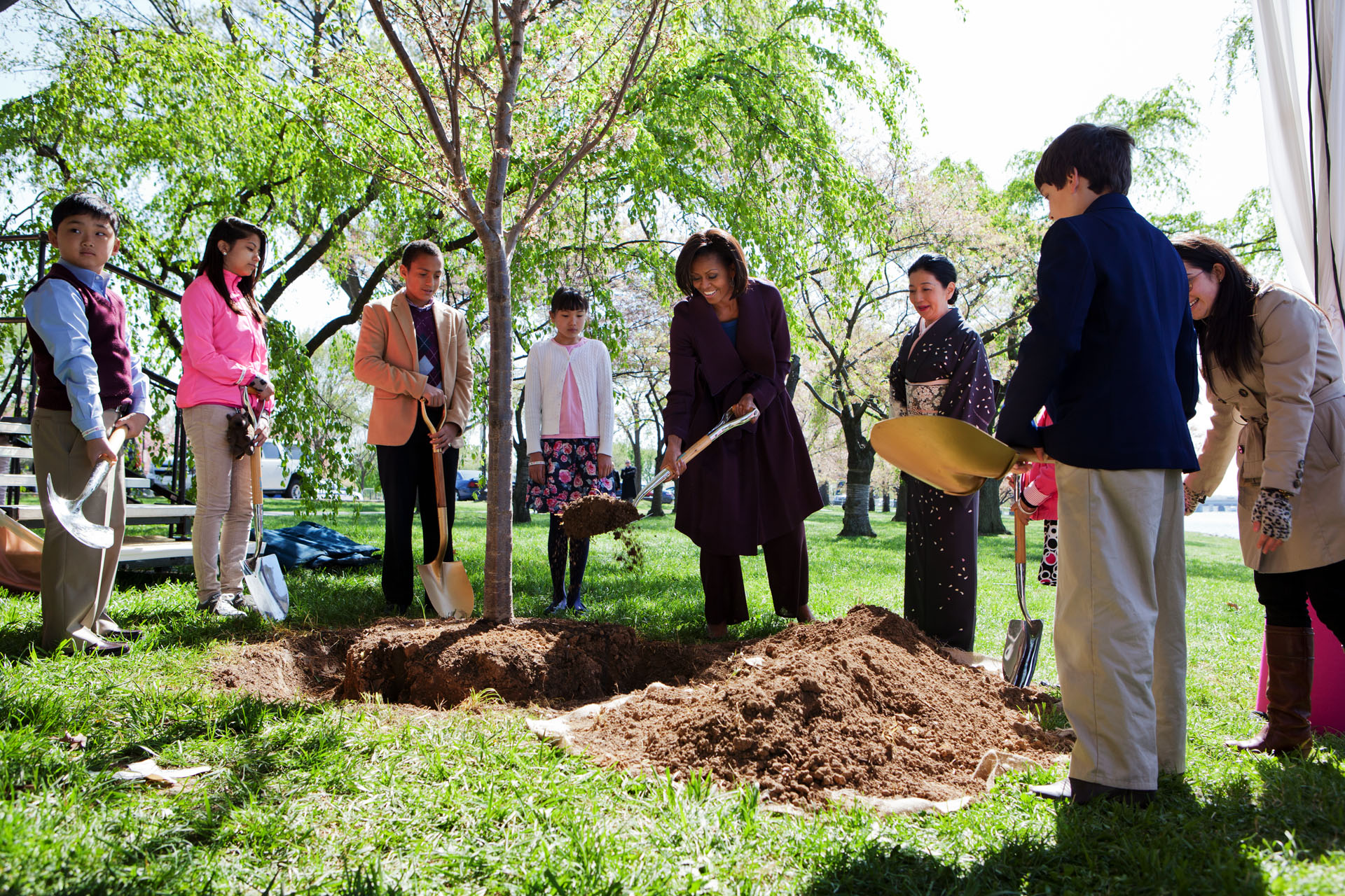 First Lady Michelle Obama participates in a centennial tree planting ceremony during the National Cherry Blossom Festival (March 27, 2012)