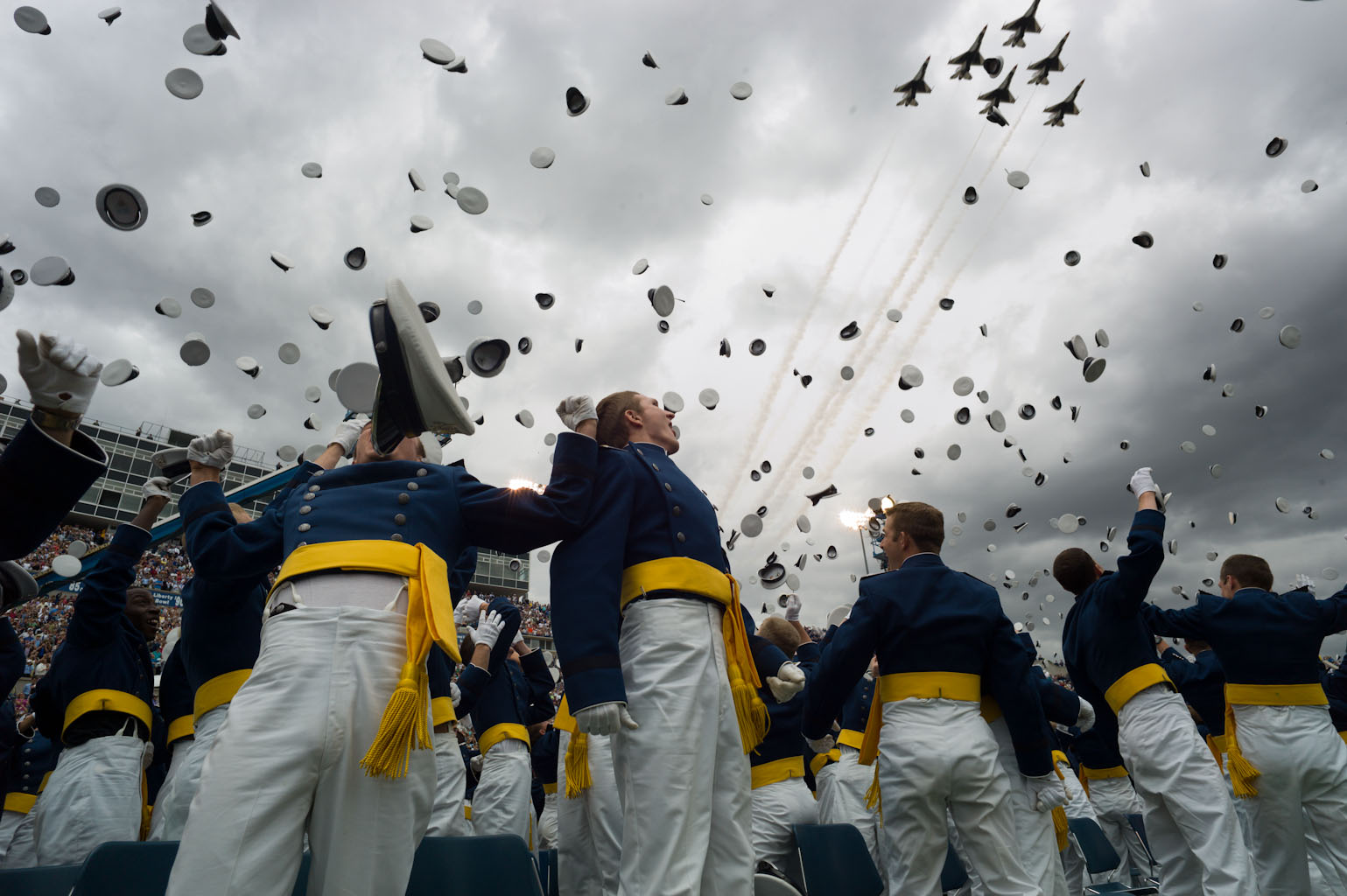 Graduates toss their hats as the Thunderbirds flyover during the United States Air Force Academy commencement ceremony (May 23, 2012)