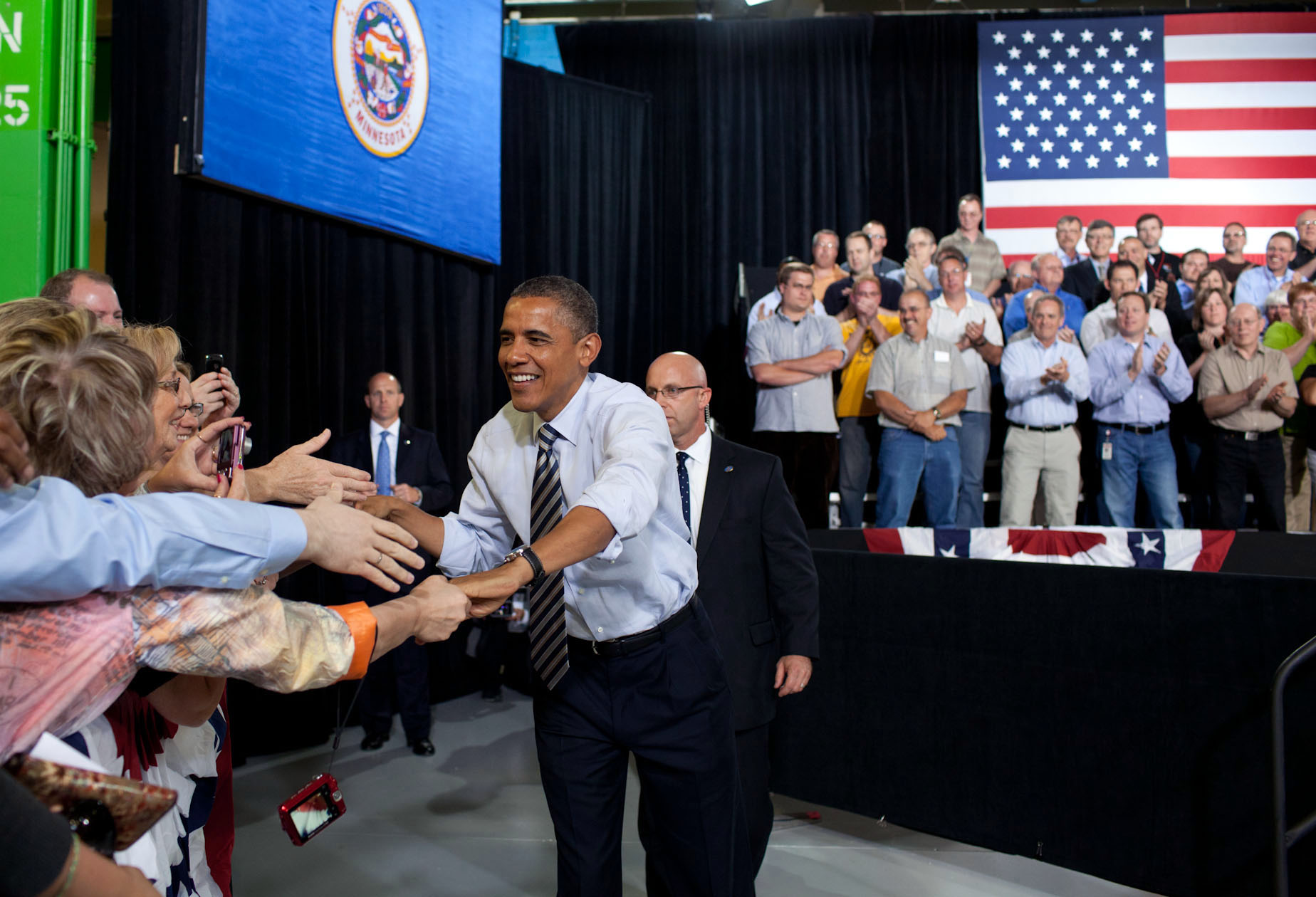 President Barack Obama greets people in the crowd at the Honeywell Golden Valley Facility (June 1, 2012)