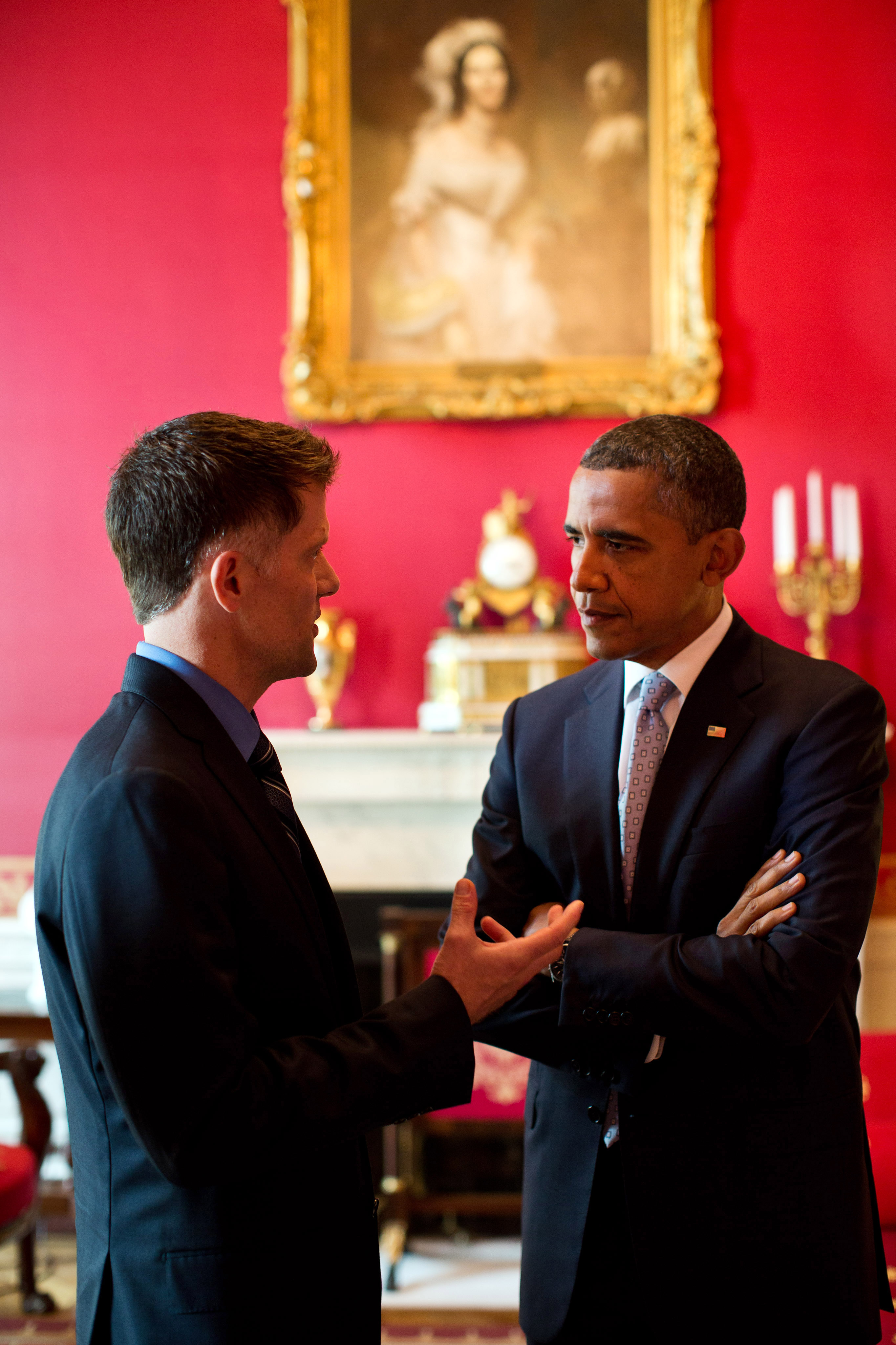President Barack Obama talks with Grant Colfax, Director of the Office of National AIDS Policy (July 26, 2012)