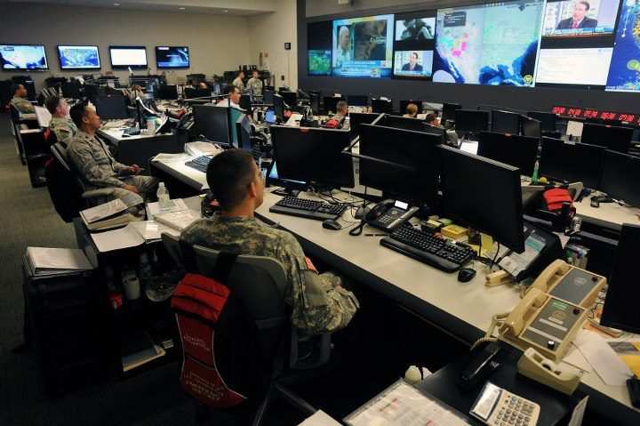 Personnel in the National Guard Command Center monitor Tropical Storm Isaac (August 29, 2012)
