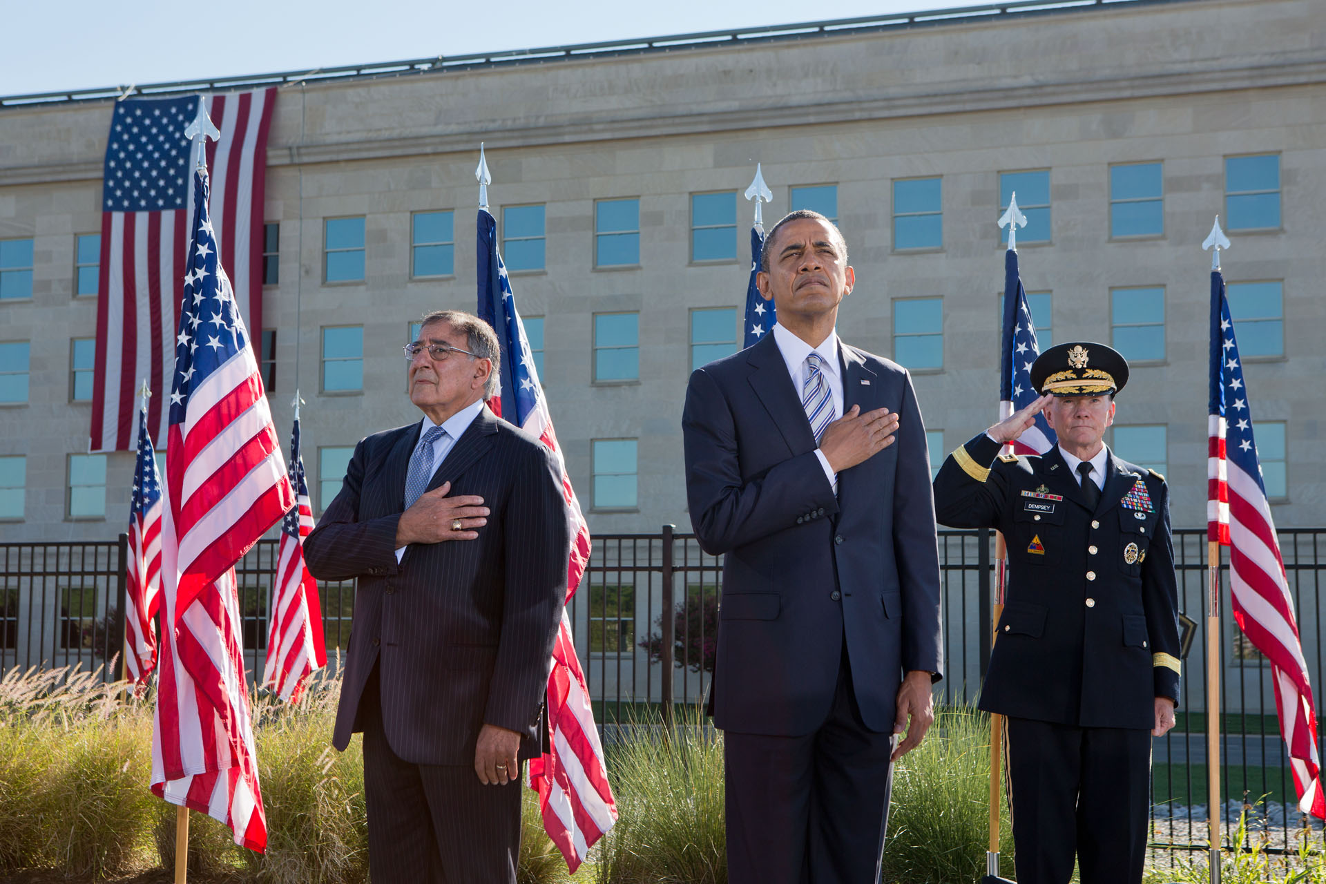 President Barack Obama, Defense Secretary Leon Panetta, and Gen. Martin Dempsey, stand during the playing of Taps (September 11, 2012)