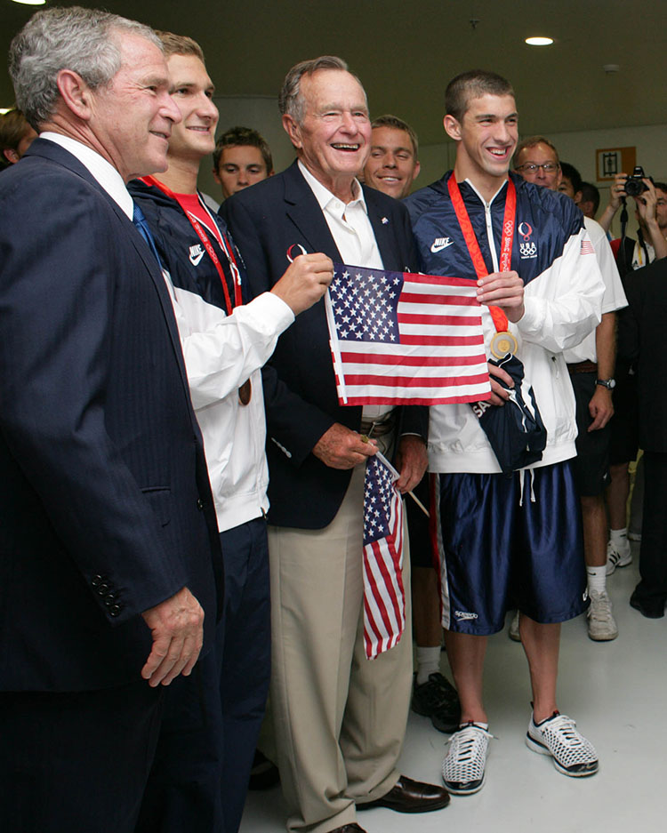 President George W. Bush and President George H.W. Bush with U.S. Olympic swimmers