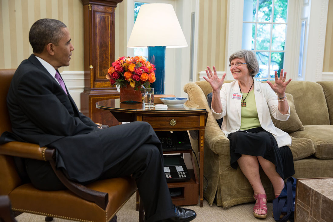 President Barack Obama talks with Sister Simone from Nuns on a Bus in the Oval Office, May 30, 2013.