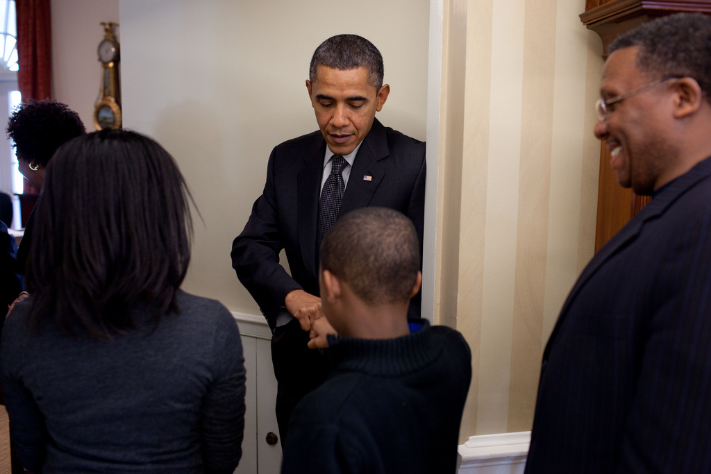 President Barack Obama greets the Sinkfield family in the Outer Oval Office