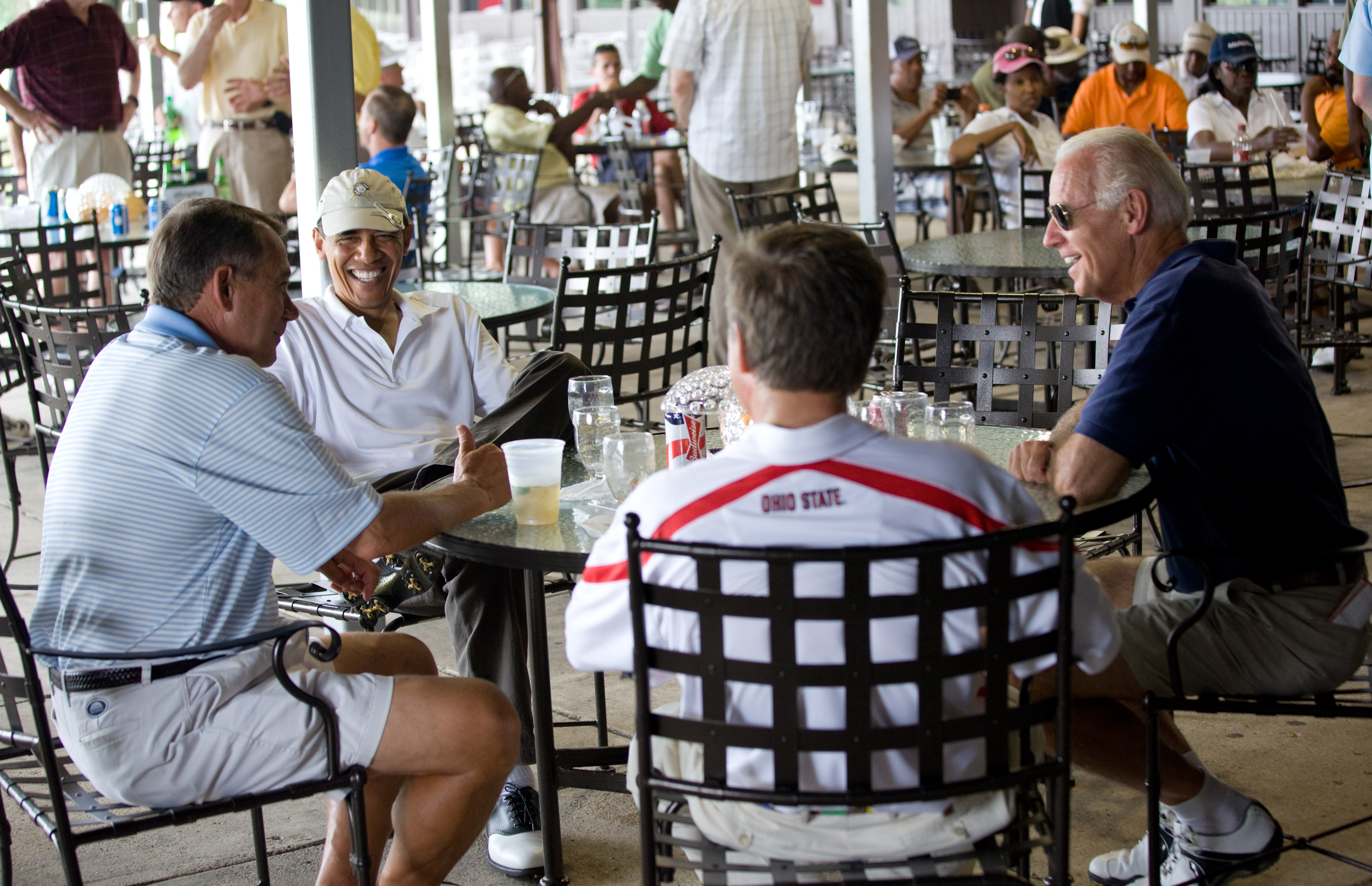 After playing a round of golf, President Barack Obama has a drink with Vice President Joe Biden