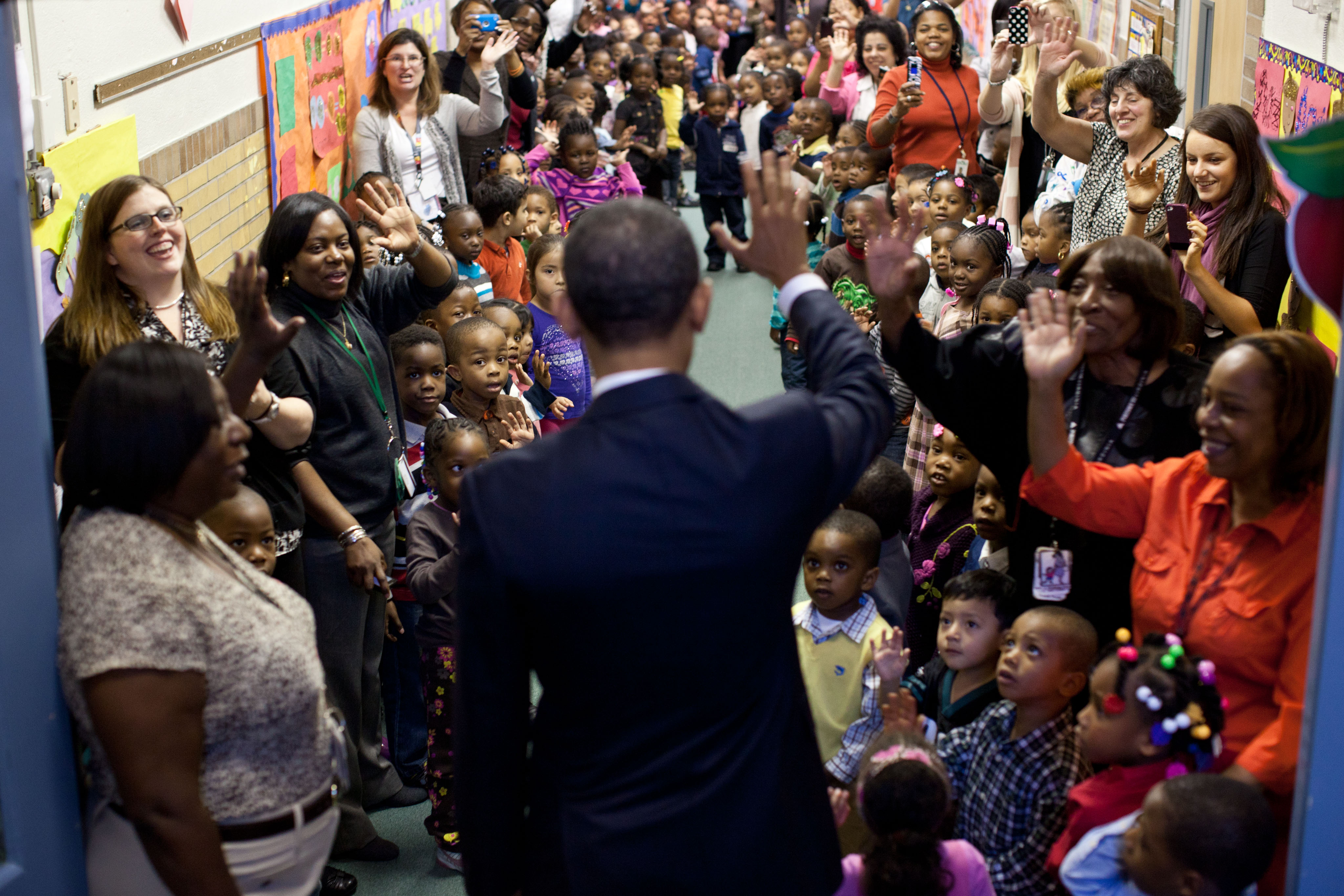 President Obama says goodbye to students after a visit to the Yeadon Regional Head Start Center