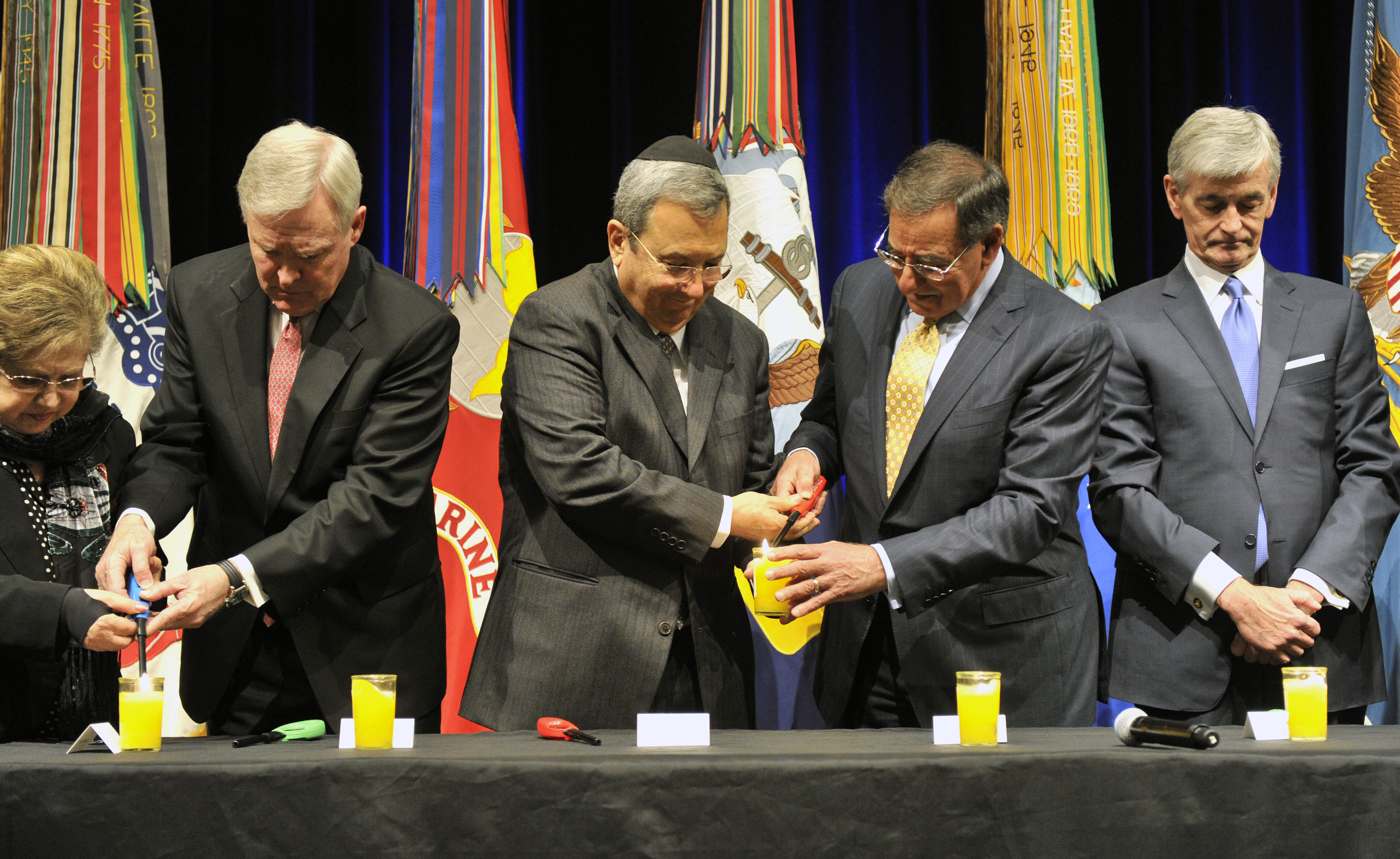 Secretary Panetta and Israeli Defense Minister Barak Light a Candle at Holocaust Remembrance Ceremony