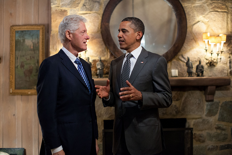 President Barack Obama talks with former President Bill Clinton before an event in McLean, Va.