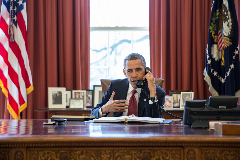 President Barack Obama talks on the phone with Nicole Hockley and families of the victims of the Sandy Hook Elementary School shootings