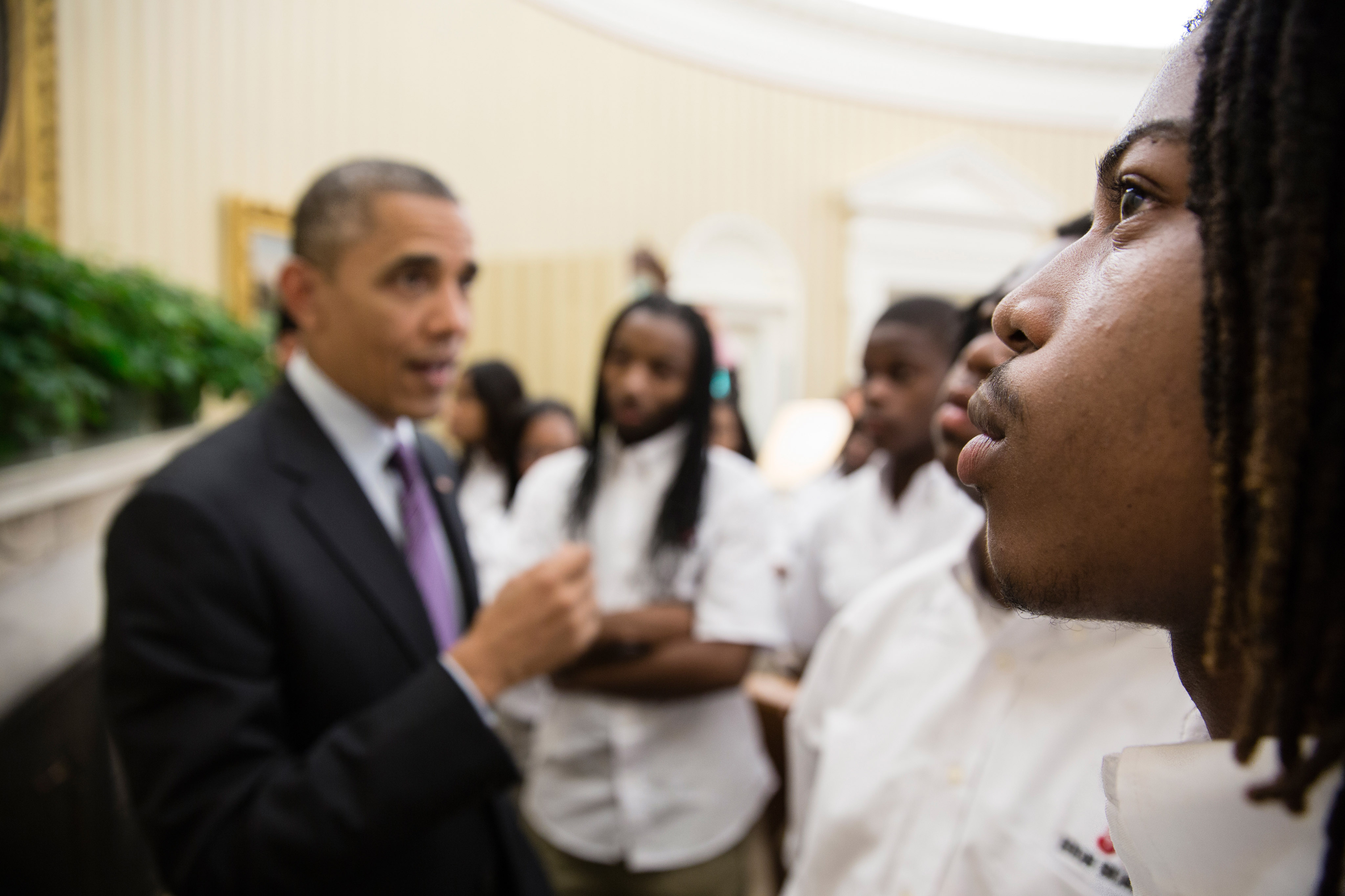 A student eyes the Emancipation Proclamation as the President gave students from William R. Harper High School in Chicago a tour of the Oval Office.