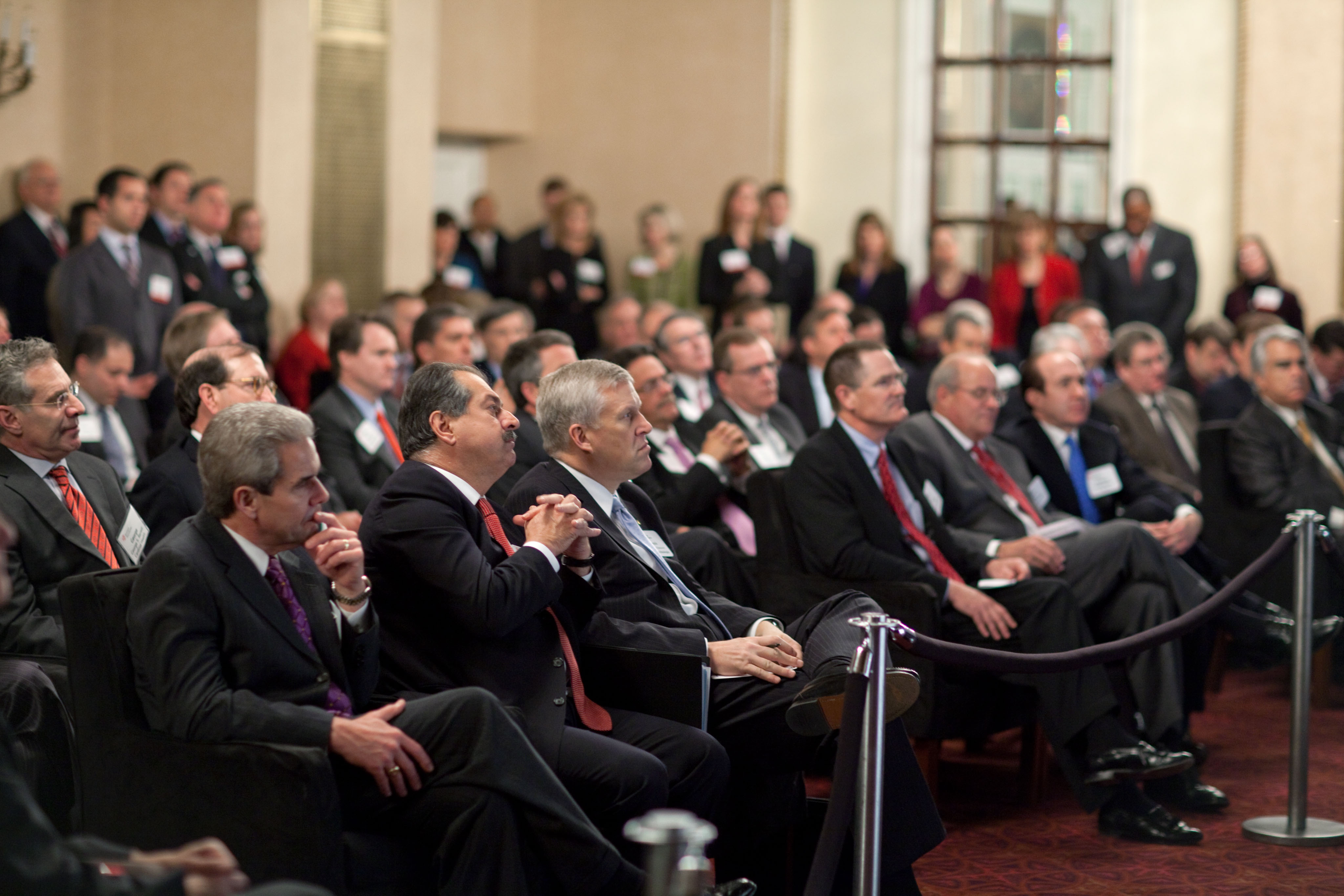Business Leaders at watch President Obama Address the Business Roundtable