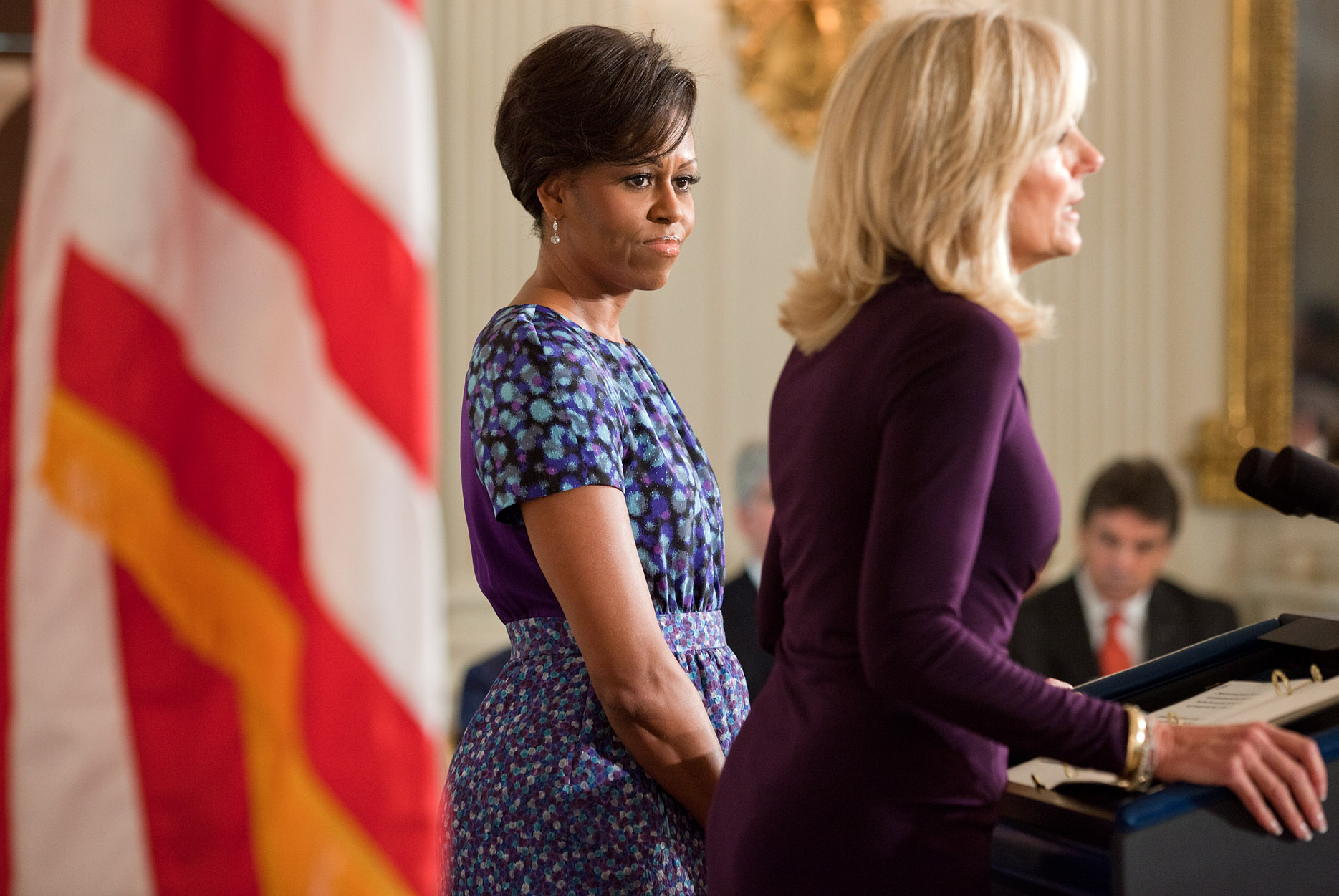 First Lady Michelle Obama listens as Dr. Jill Biden delivers remarks to a bipartisan group of governors attending the National Governors Association's meeting