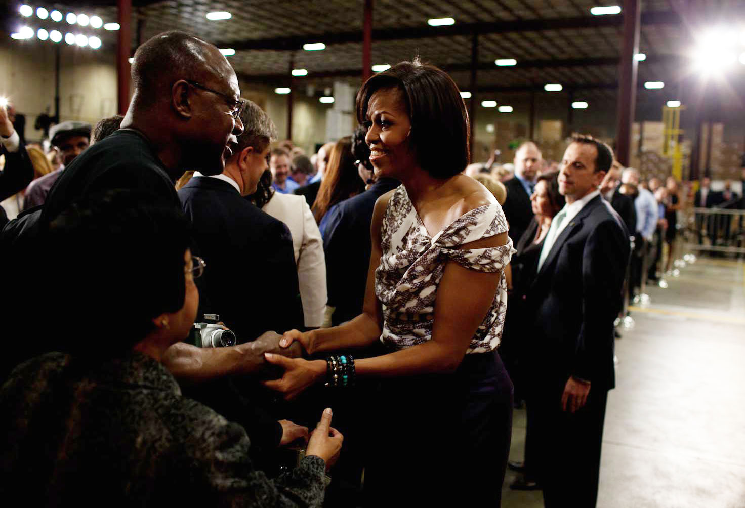 First Lady Michelle Obama greets people following her remarks at a SEARS distribution center 1