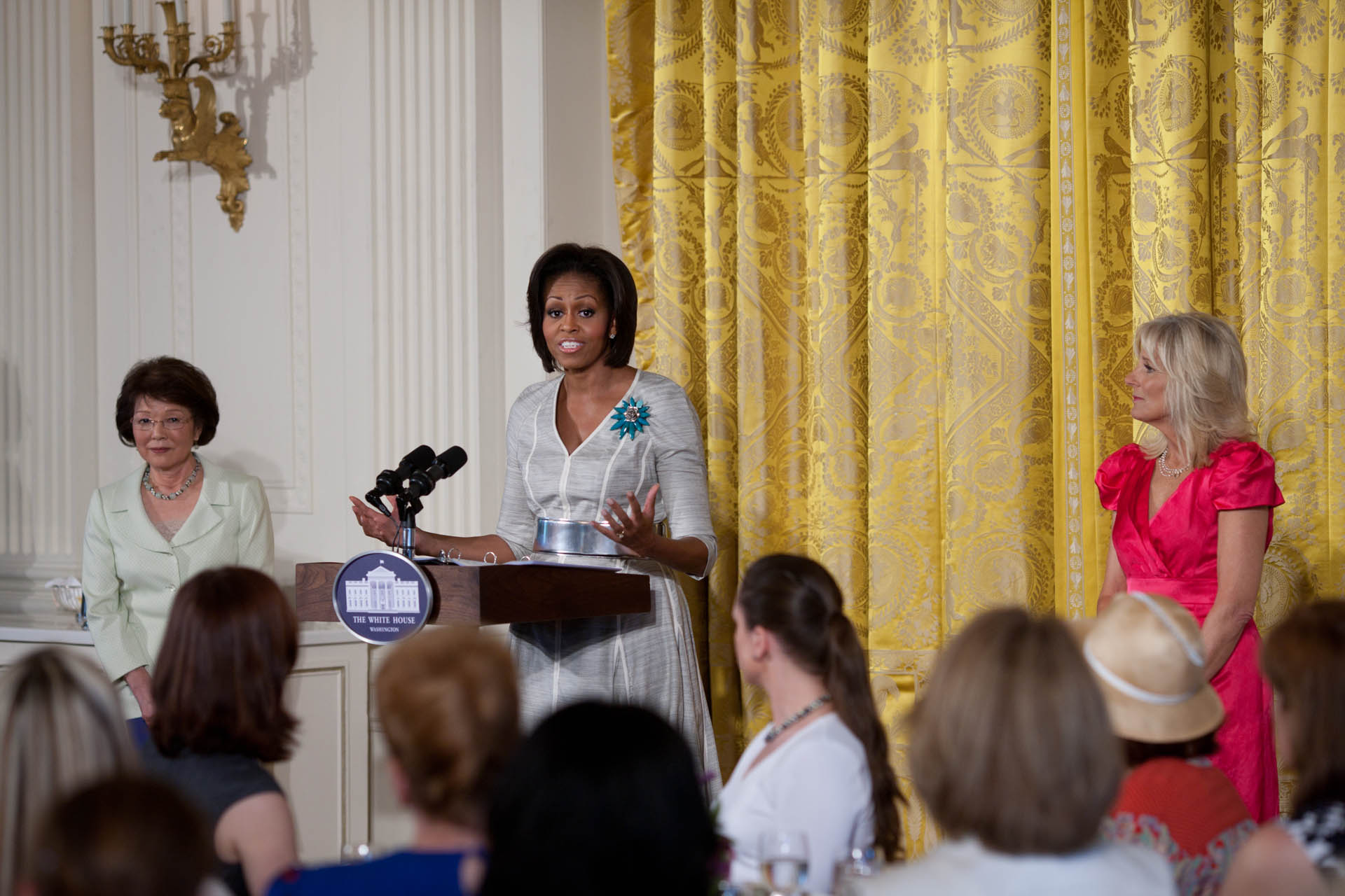 First Lady Michelle Obama addresses military spouses, relatives and friends in the East Room of the White House for a Mother's Day Tea Party