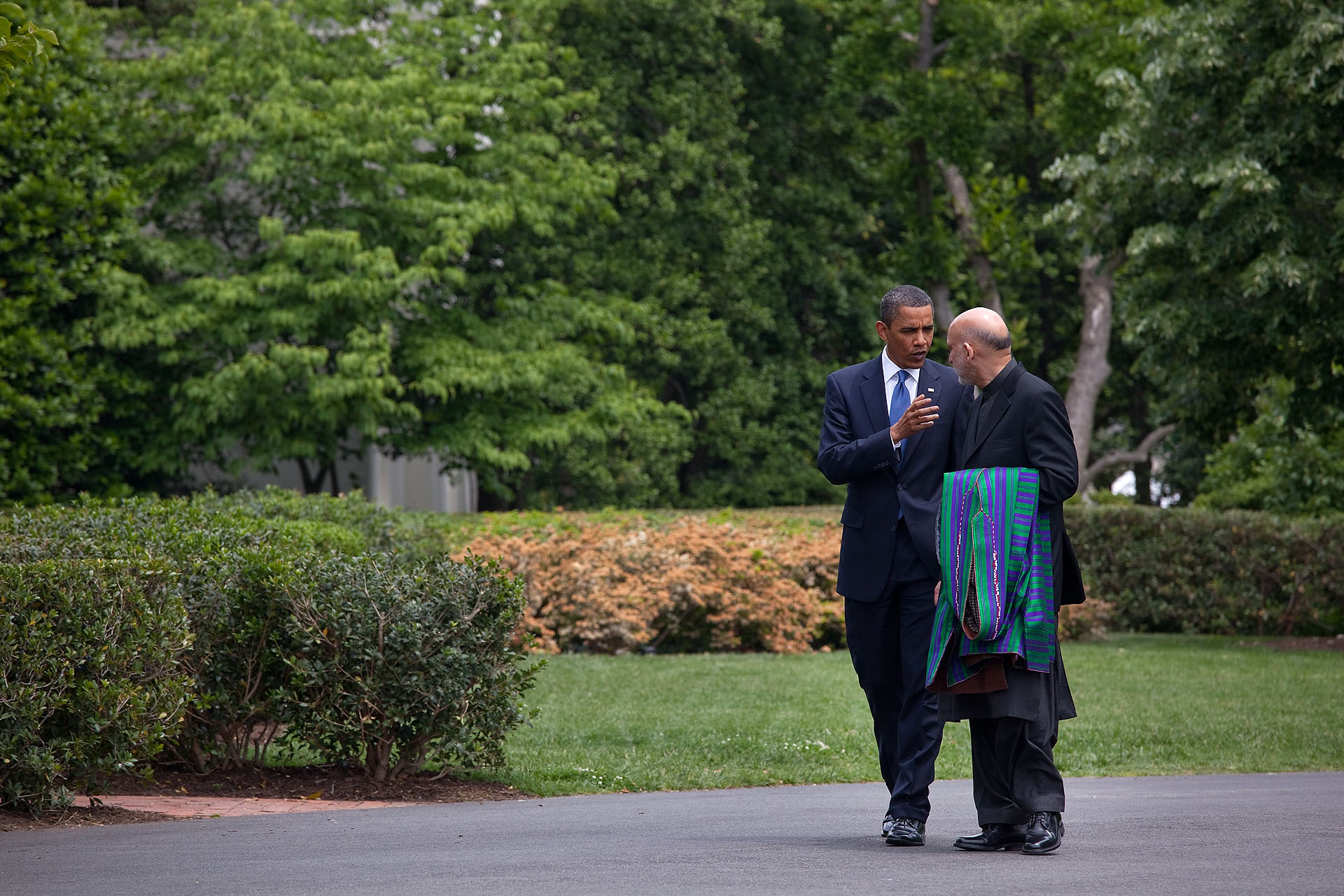 President Obama and President Karzai Walk along the South Lawn