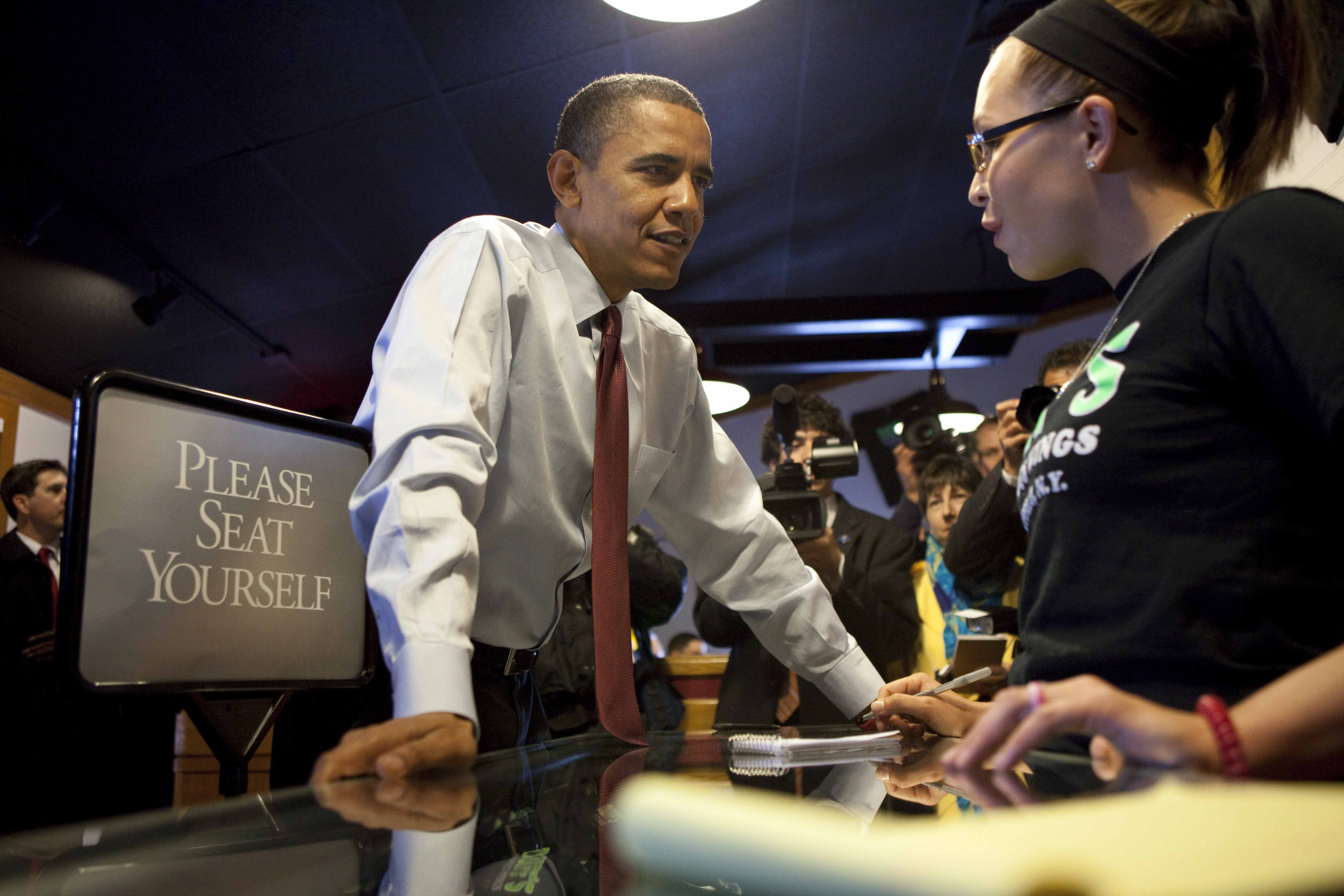 President Barack Obama places his order for wings