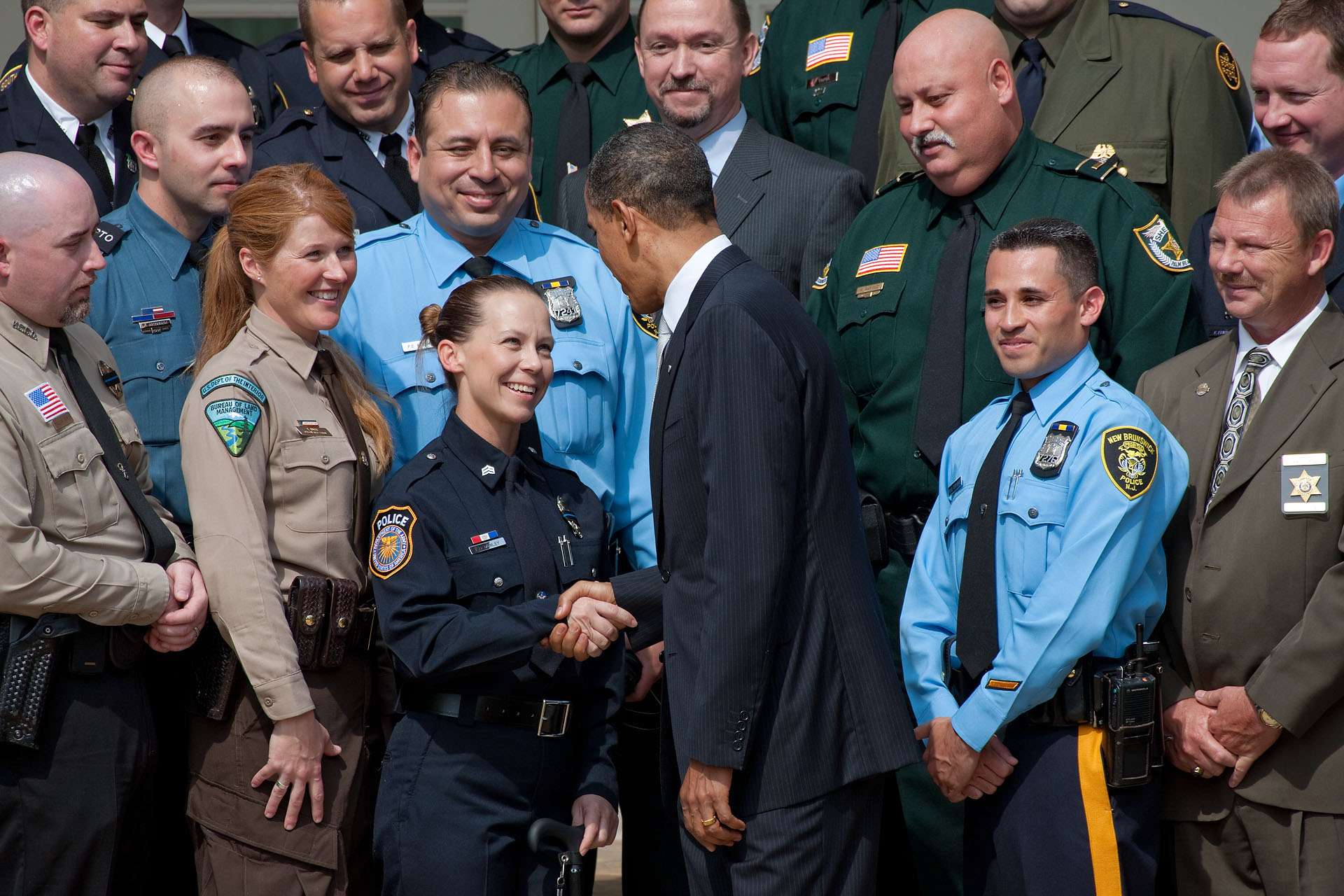 President Barack Obama talks with Sgt. Kimberly Munley