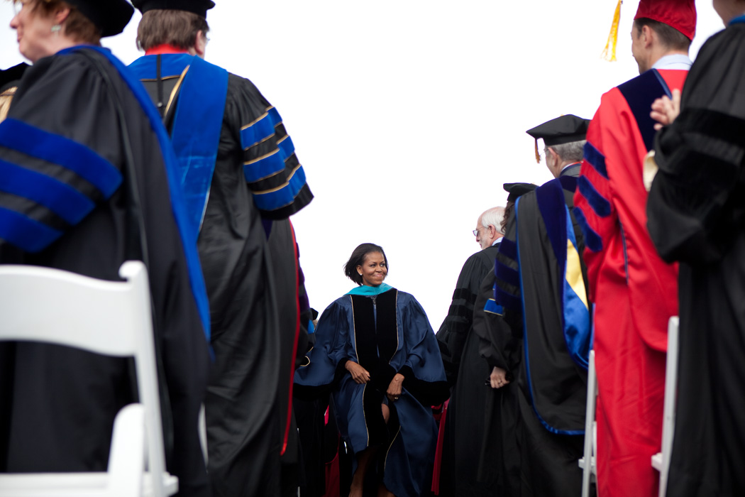 Michelle Obama stands on stage during the GWU commencement ceremony