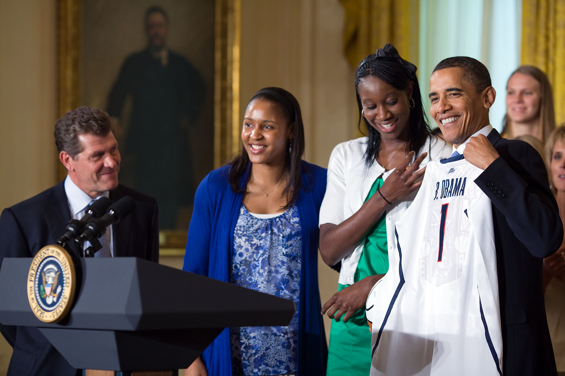 President Obama Presented With Team Jersey by UConn Huskies