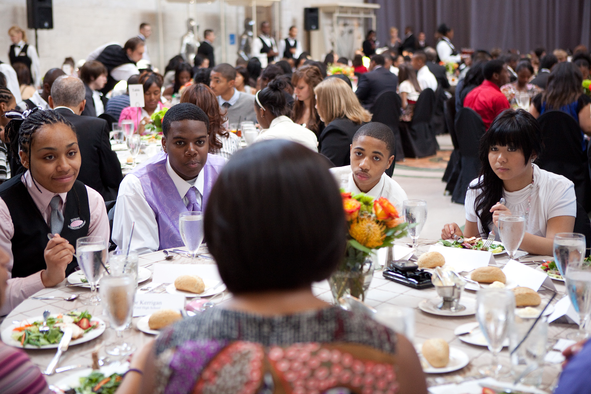 Students listen to First Lady Michelle Obama during a mentoring luncheon in Detroit, Mich.