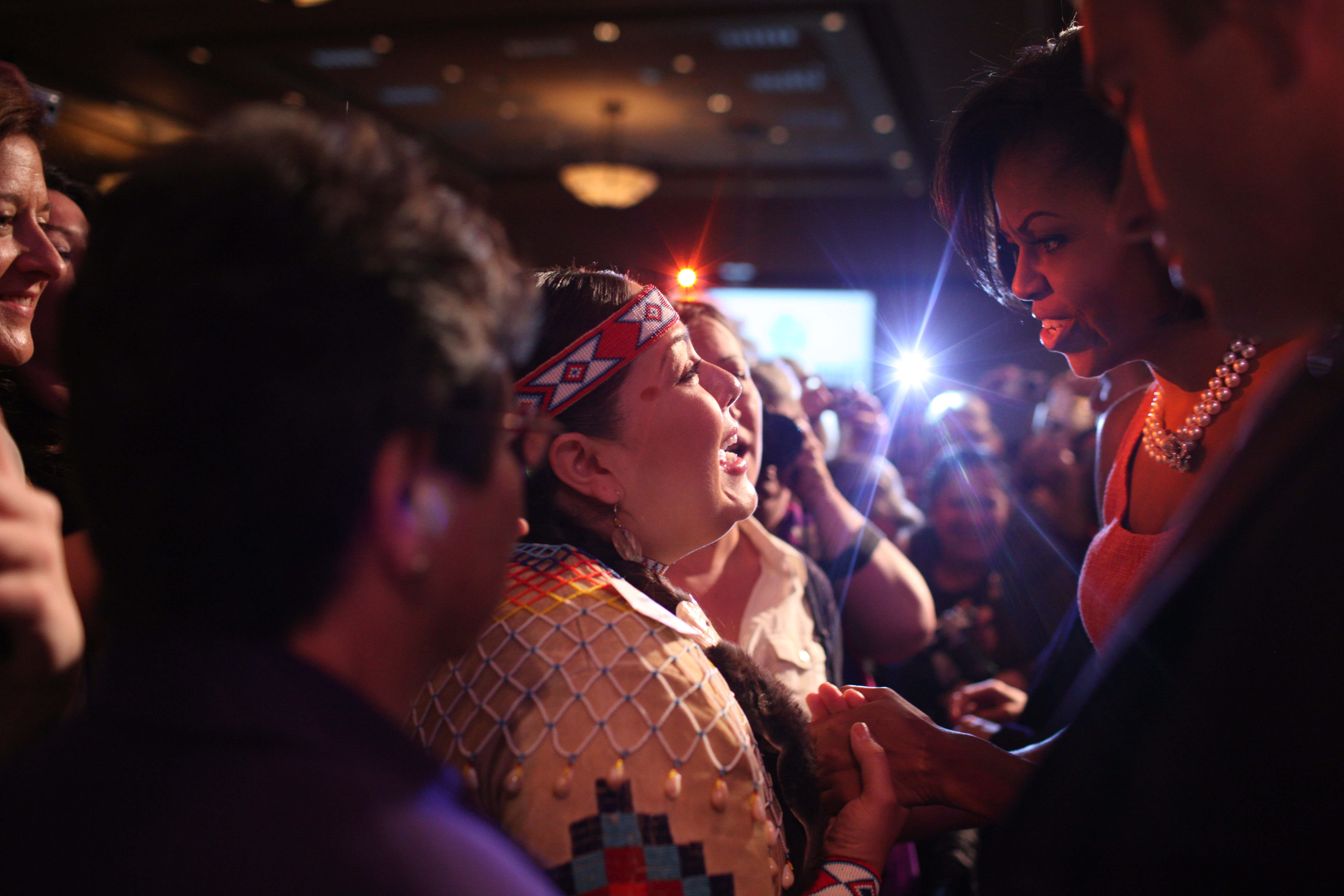 First Lady Michelle Obama greets the crowd after making remarks at the Women's Summit