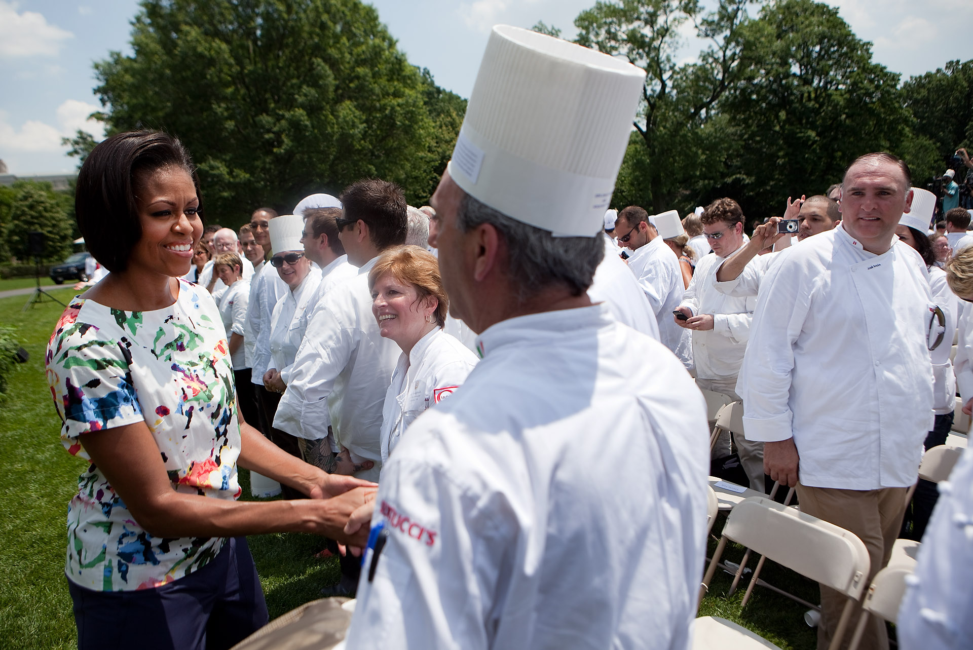 First Lady Michelle Obama greets one of the hundreds of chefs