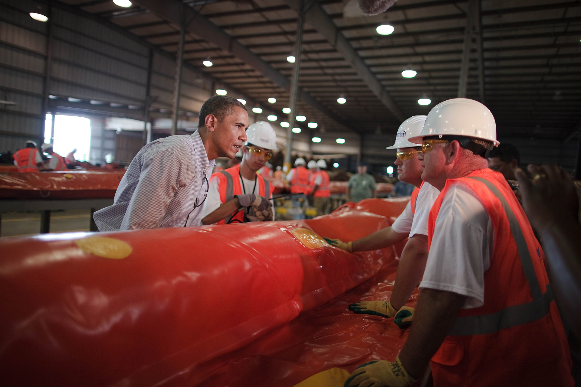 President Obama and workers in Theodore Staging Facility