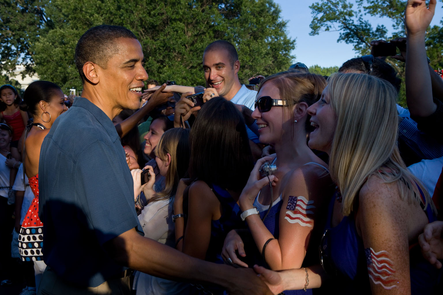 President Barack Obama and First Lady Michelle Obama greet military families