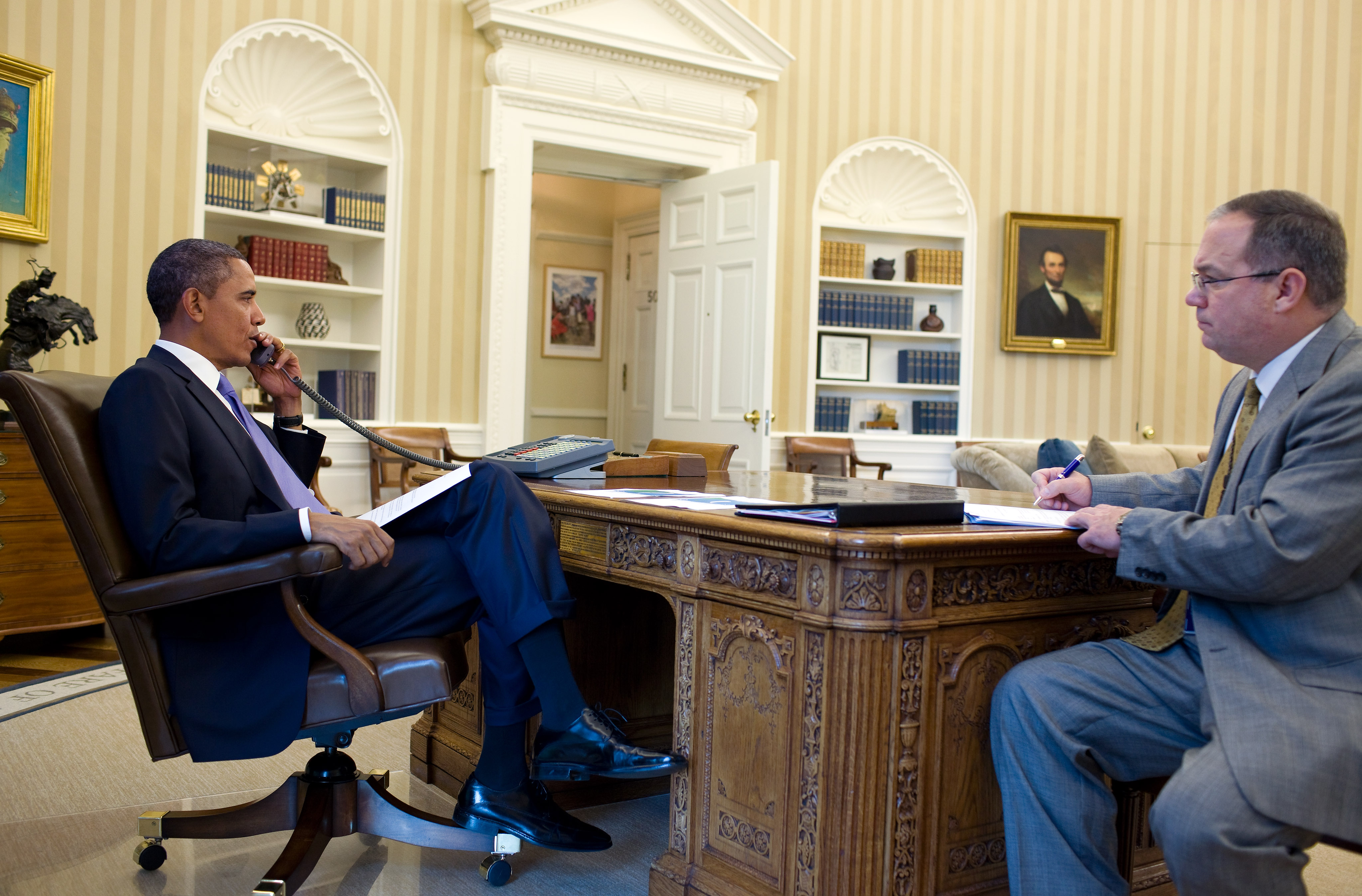 President Barack Obama talks on the phone with FEMA Administrator Craig Fugate